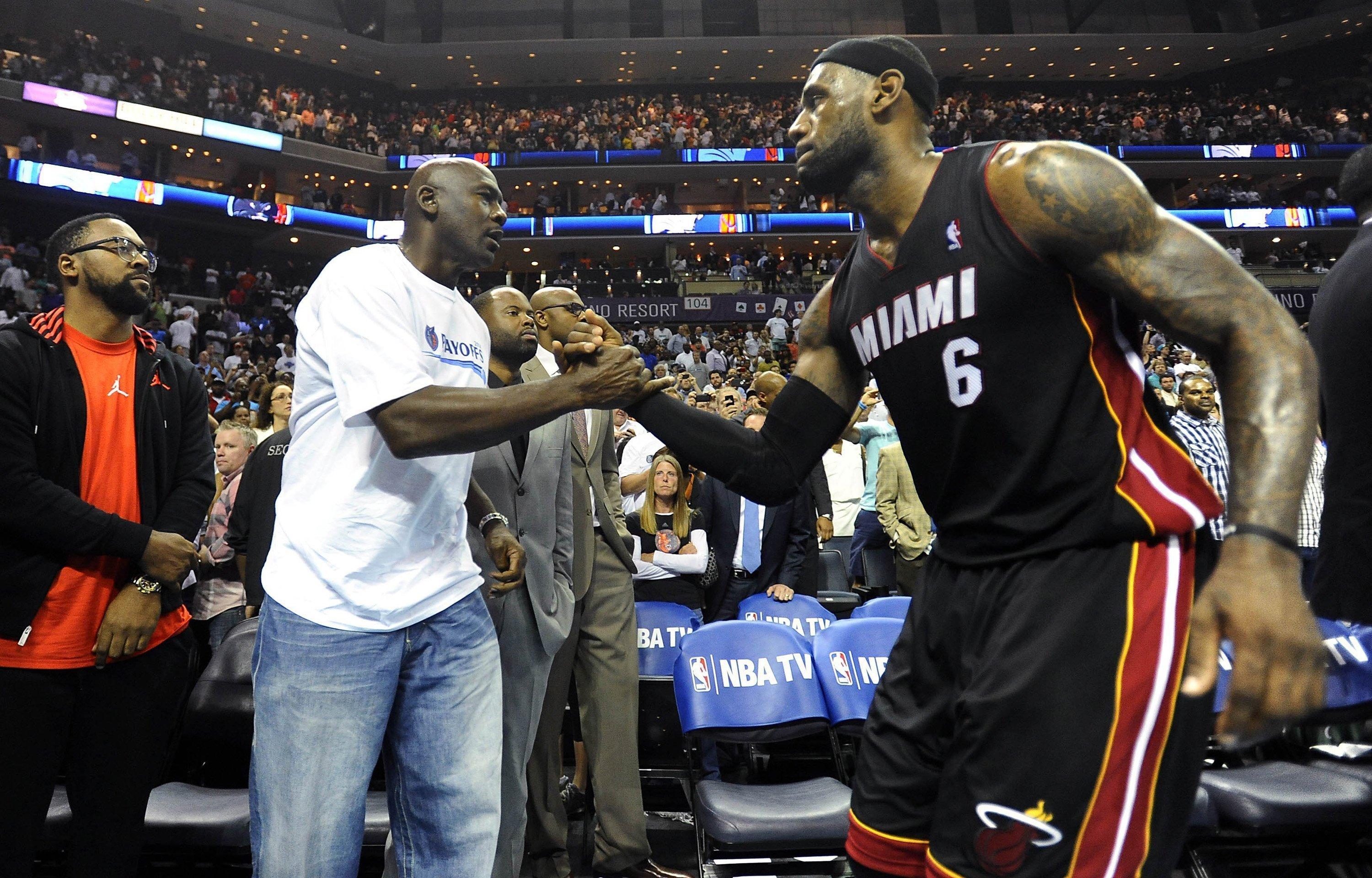 Charlotte Bobcats' team owner Michael Jordan shakes hands with Miami Heat forward LeBron James (6), after the Heat defeated the Bobcats, 109-98, in Game 4 of the NBA Eastern Conference quarterfinals at Time Warner Cable Arena in Charlotte, N.C., Monday, April 28, 2014.