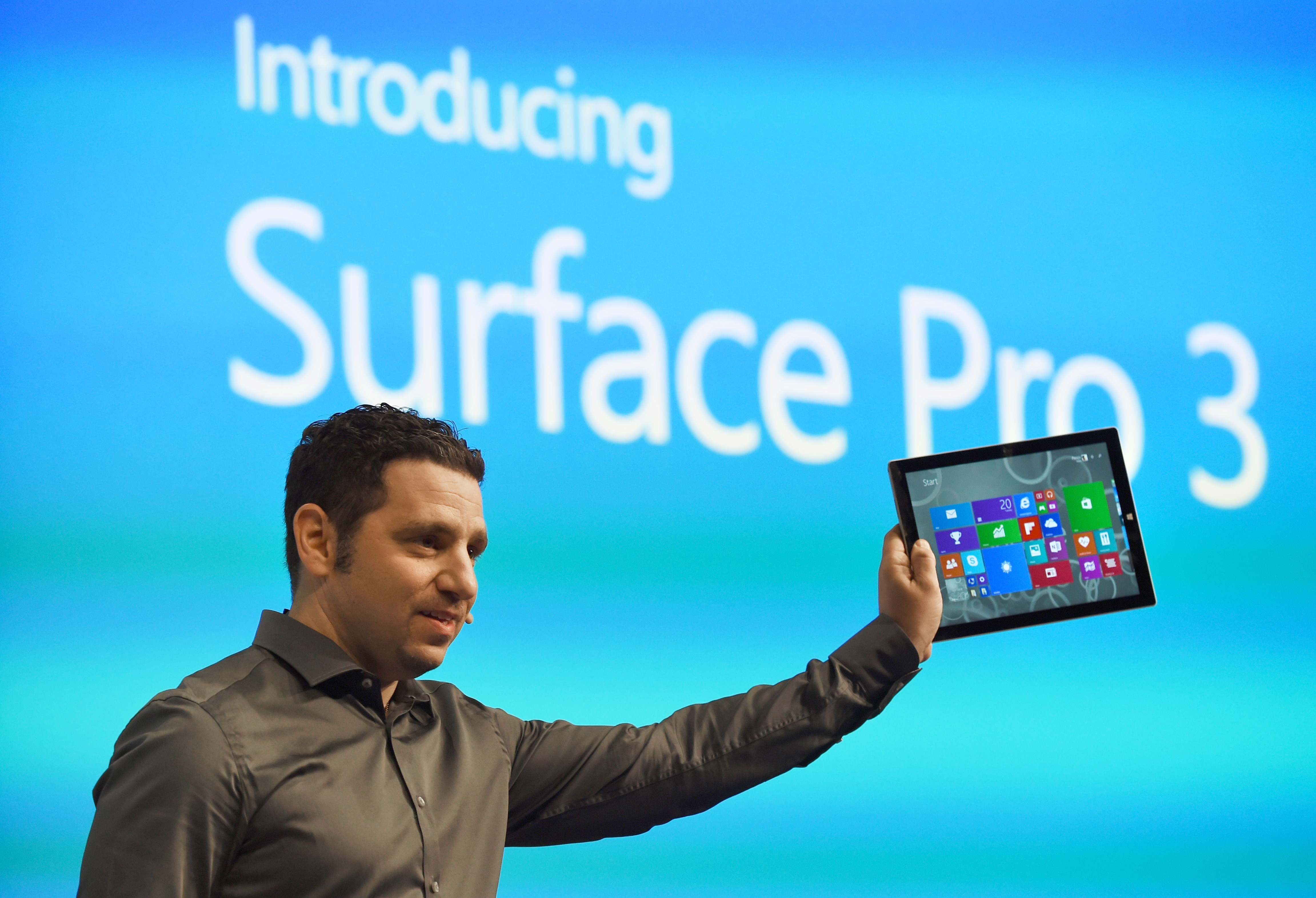 Panos Panay, corporate vice president with Microsoft's Surface division, holds the new Microsoft Surface Pro 3 tablet computer during a press conference May 20, 2014 in New York.
