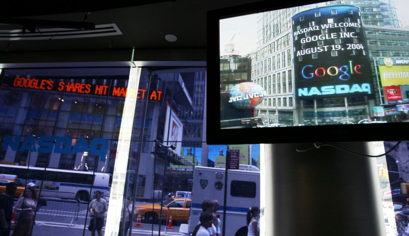 The Google logo appears on a screen and ticker inside the NASDAQ Marketsite just before the markets close Aug. 19, 2004.