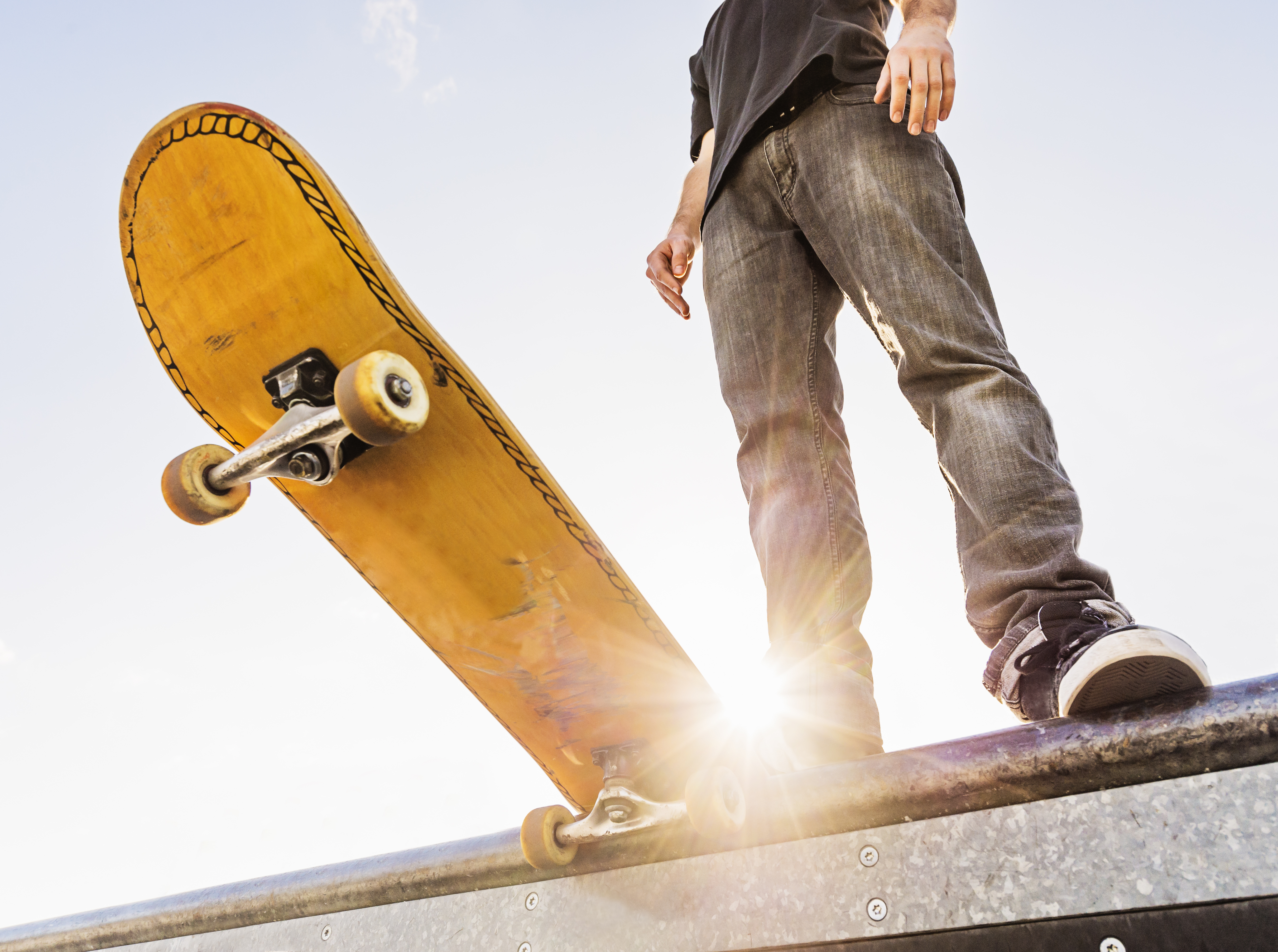 Man with skateboard at the edge of ramp