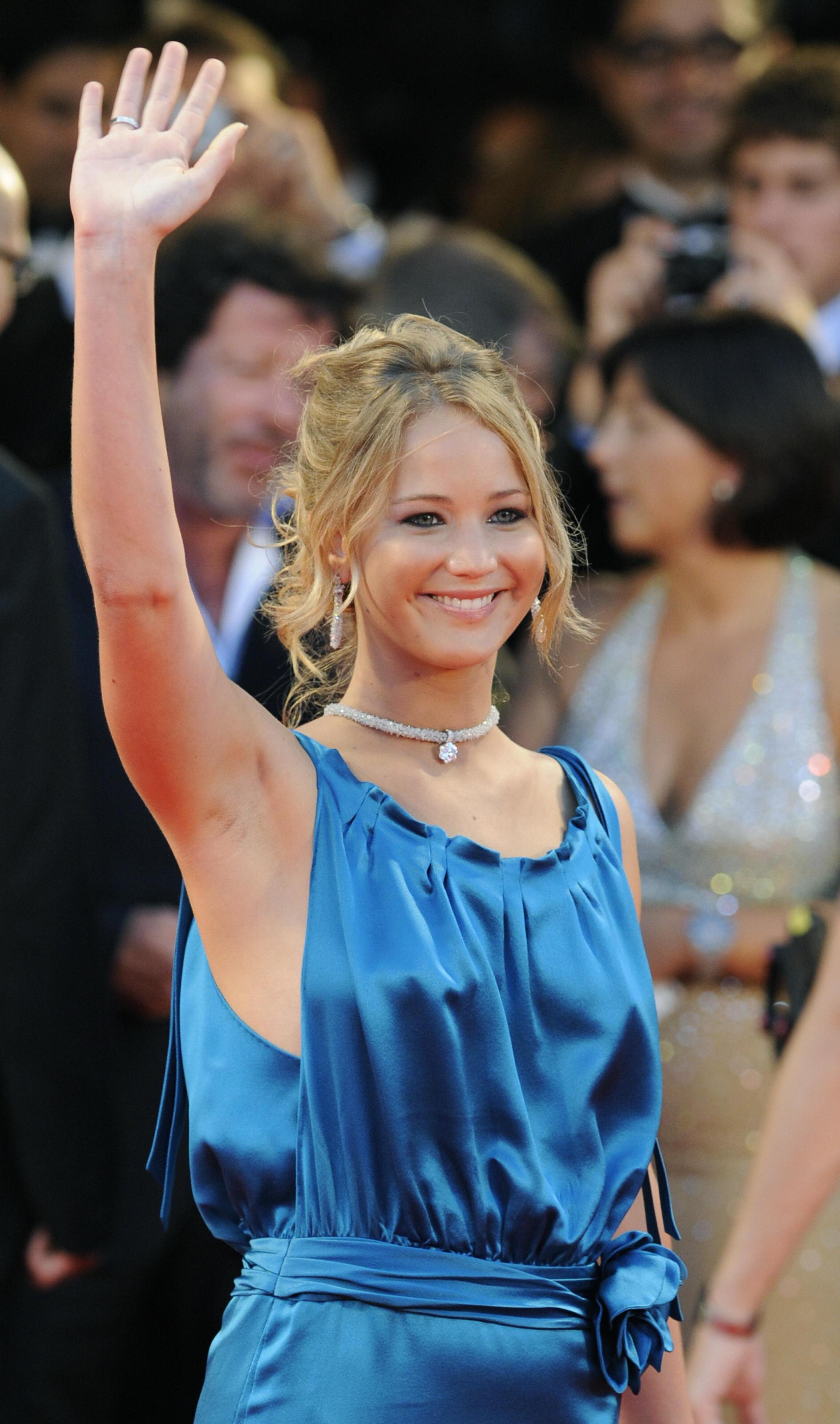 US actress  Jennifer Lawrence waves to p