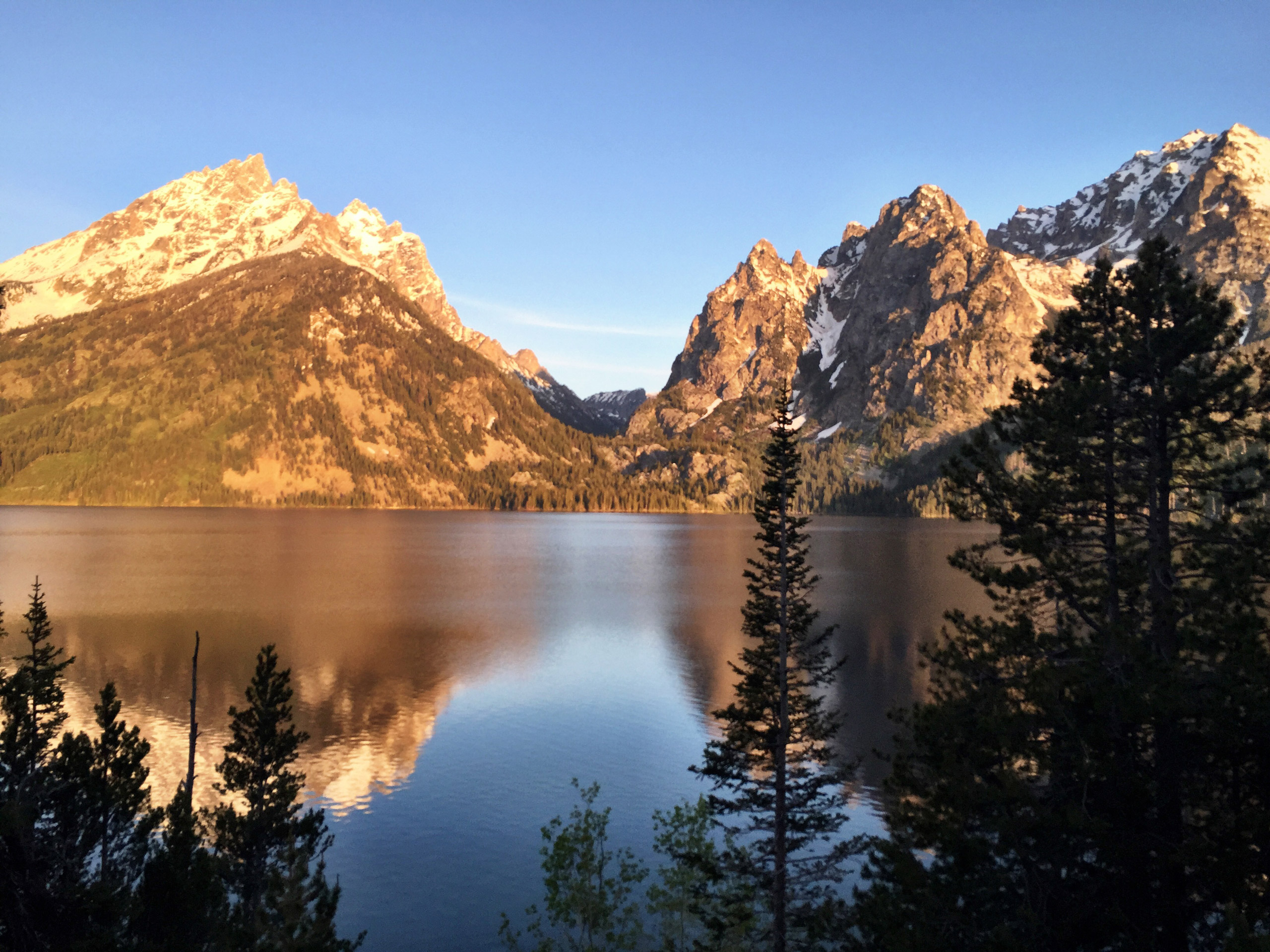 Alpenglow shining on the Grand Tetons in Grand Teton National Park, Wyoming, on June 4, 2015.
