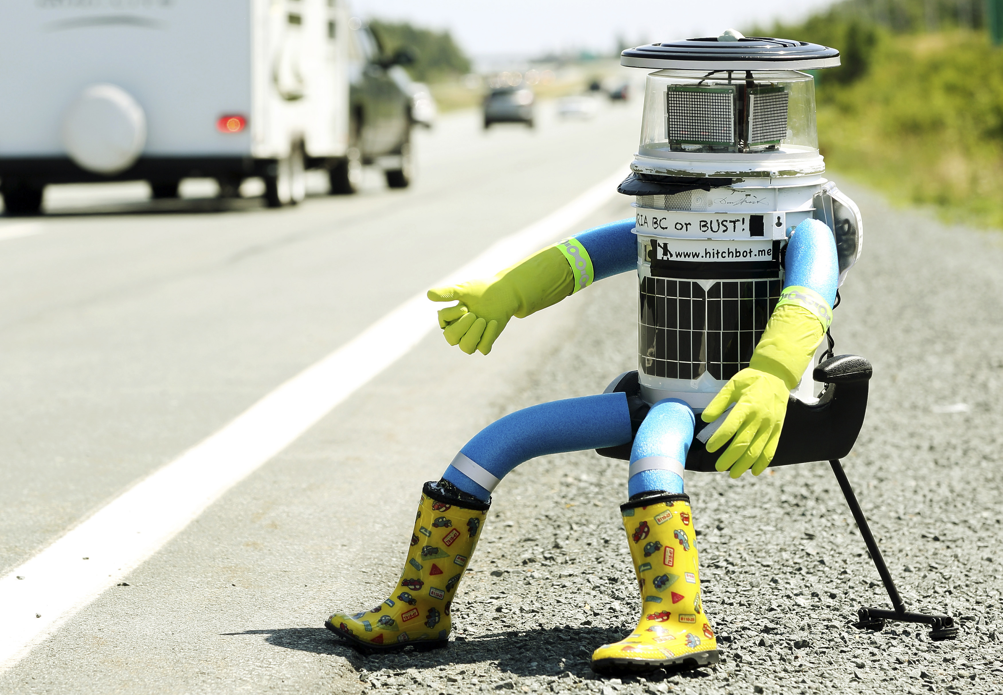 The anthropomorphic robot named hitchBOT, seen here during its cross-Canada trek in 2014, was destroyed on Aug. 1, 2015 two weeks into its attempted trip across the U.S., according to its creators