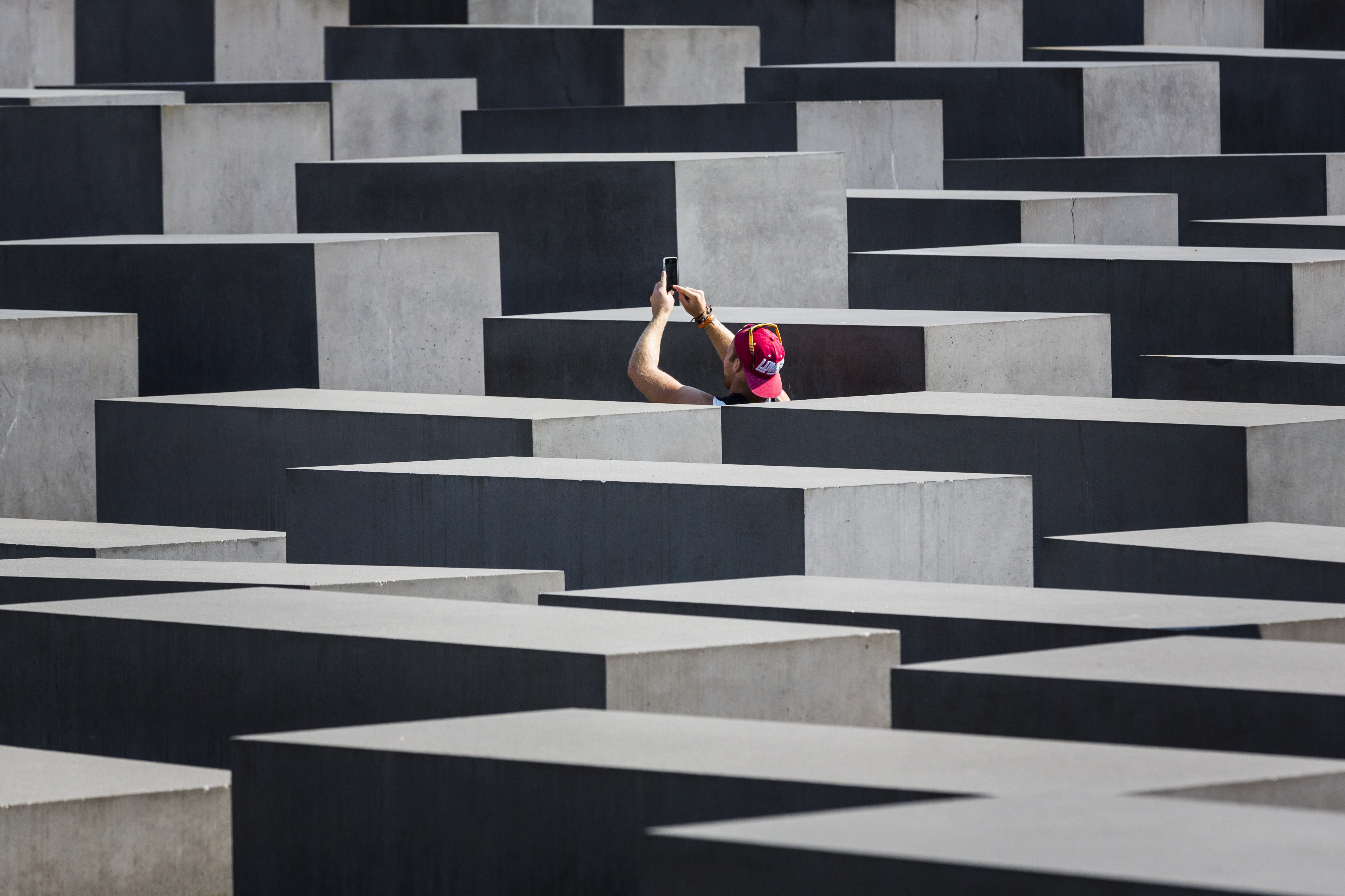 Tourist taking a photo of the concrete slabs at the Berlin Holocaust Museum in Sept. 04, 2014, in Berlin, Germany.