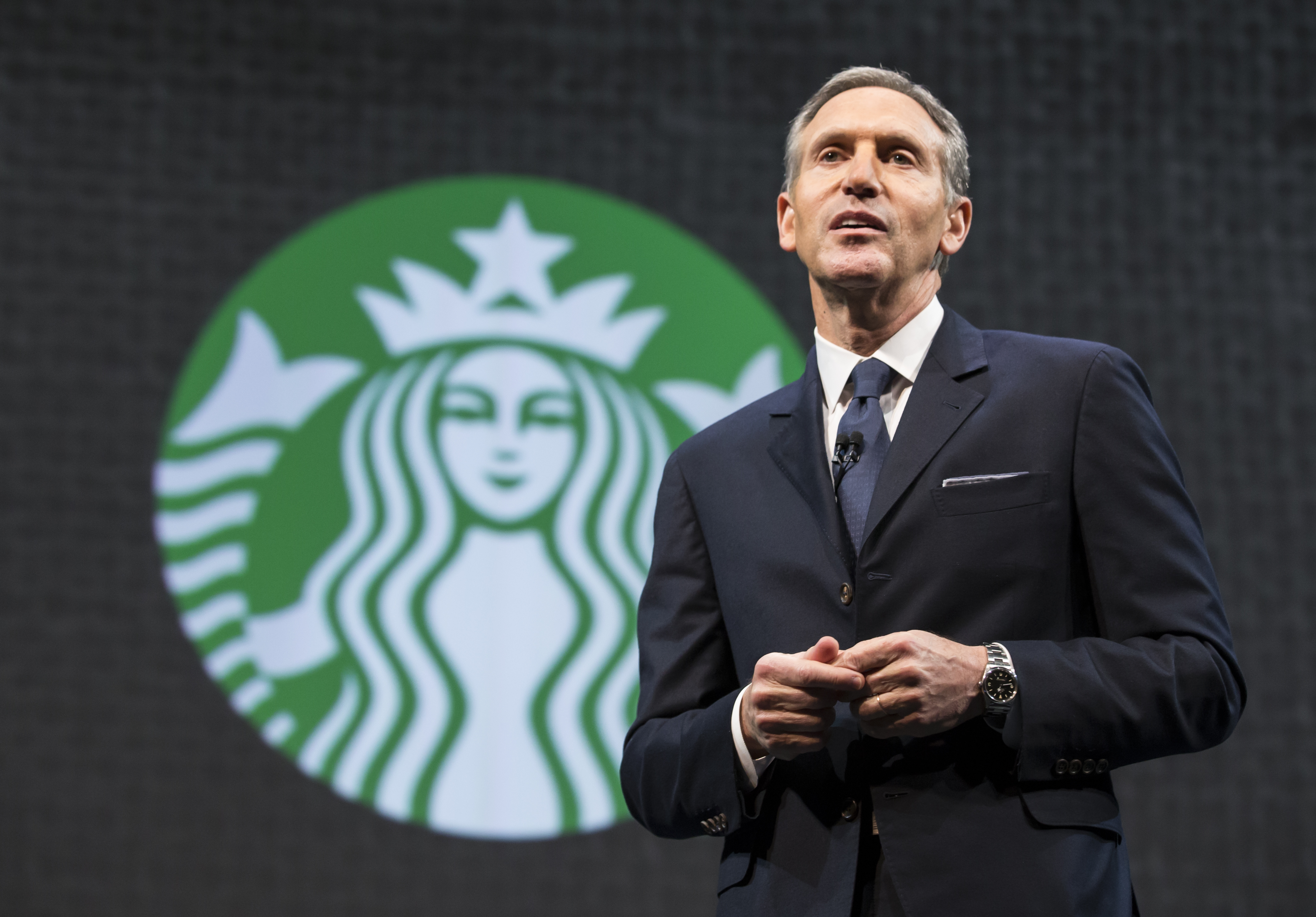 Starbucks Chairman and CEO Howard Schultz speaks during Starbucks' annual shareholders meeting on March 18, 2015 in Seattle.
