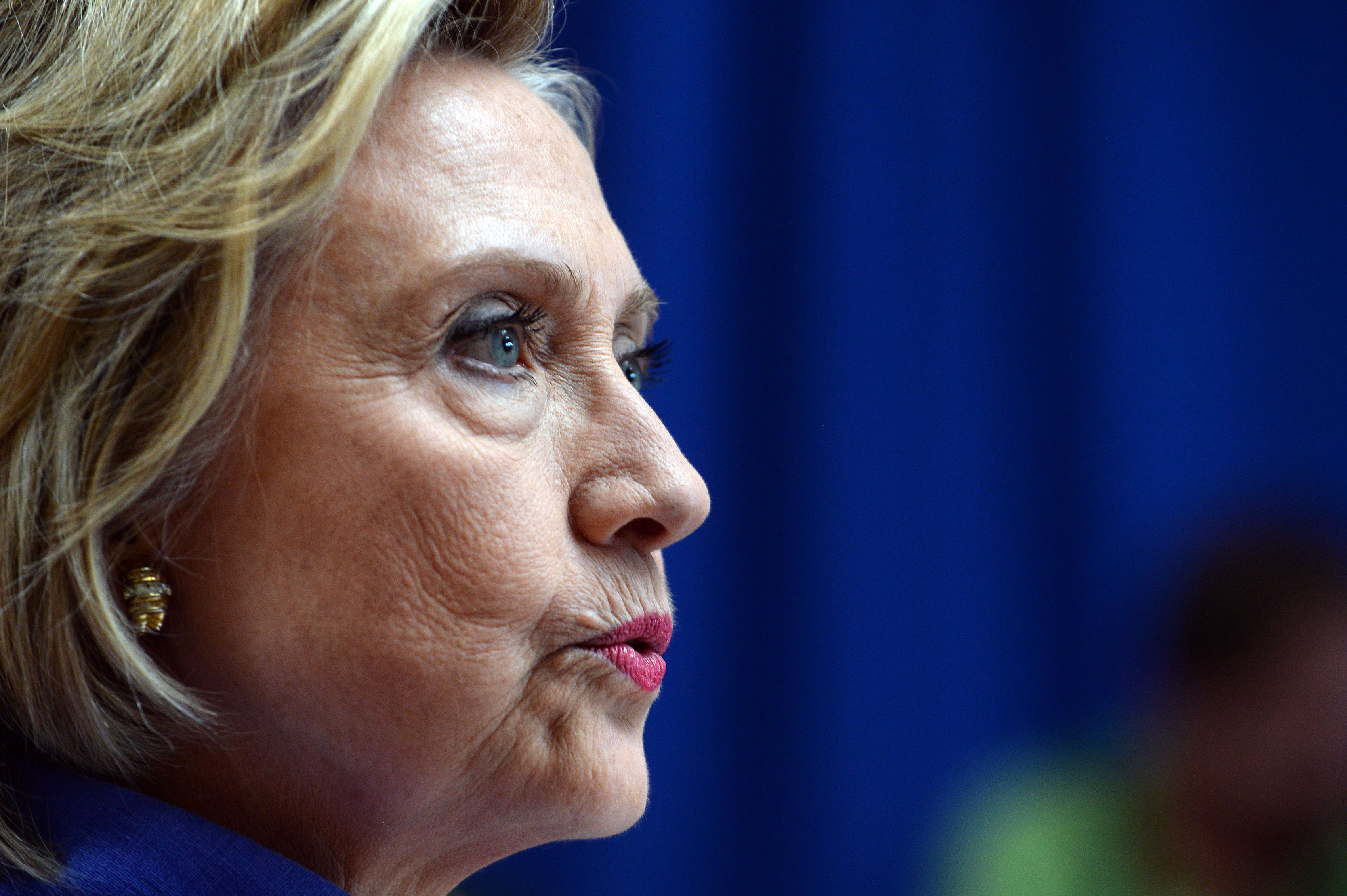 Hillary Clinton takes questions from reporters following a town hall meeting at Exeter High School in Exeter, New Hampshire, on Aug. 10, 2015.