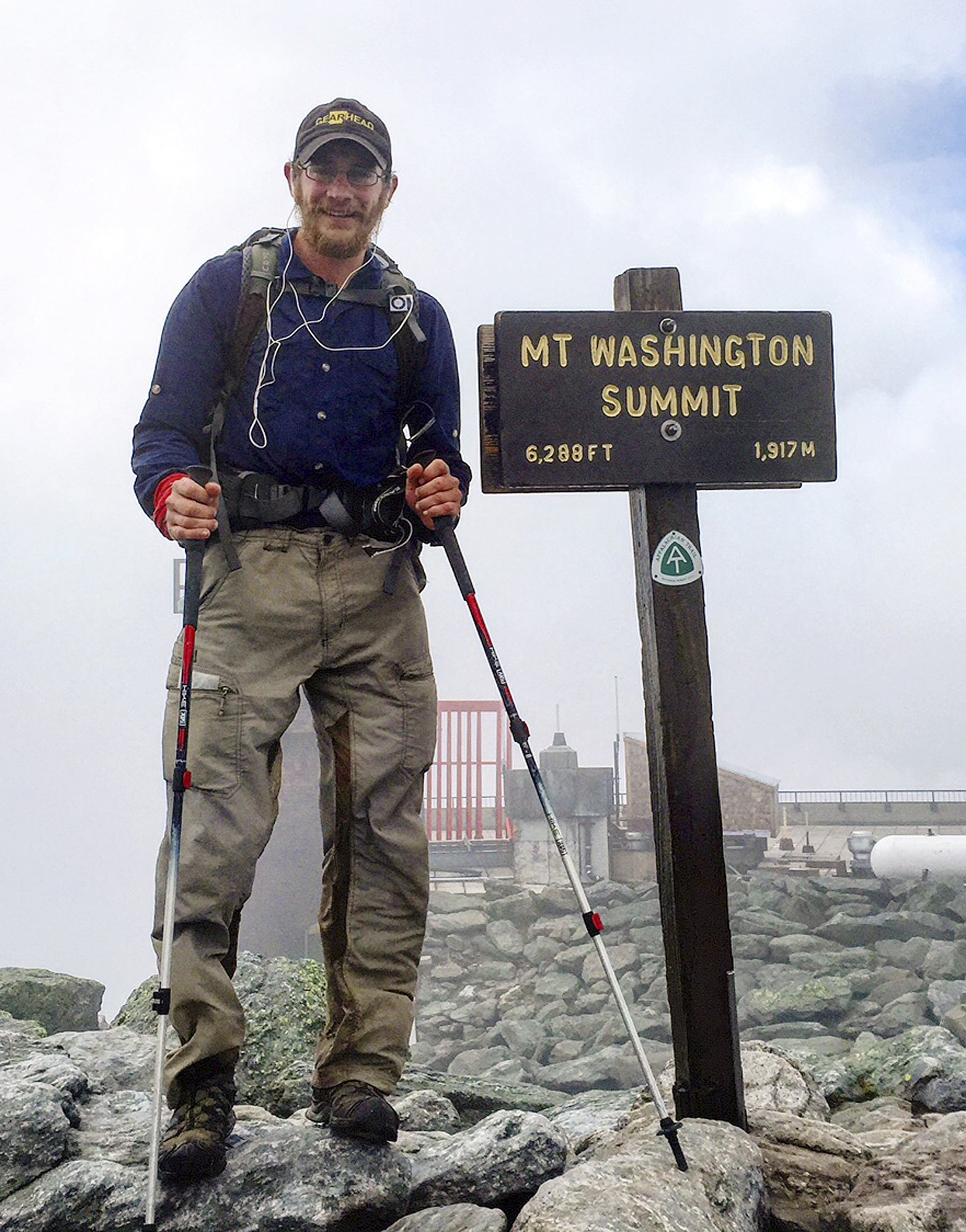 Jackson Spencer poses atop Mount Washington along the Appalachian Trail in New Hampshire on July 23, 2015.