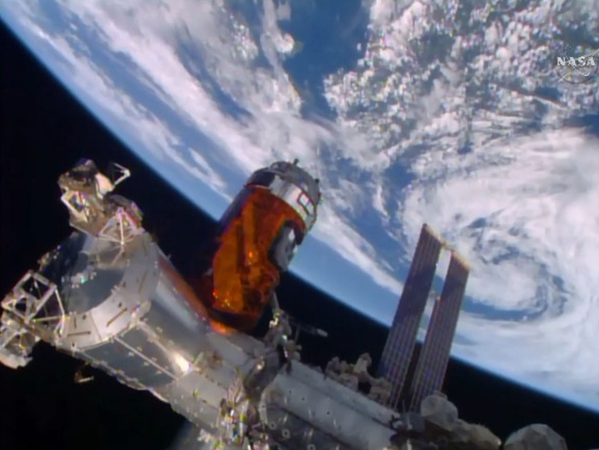 In this photo taken from NASA TV, the unmanned Japanese cargo ship, the Kounotori 5, arrives at the International Space Station on Aug. 24, 2015.