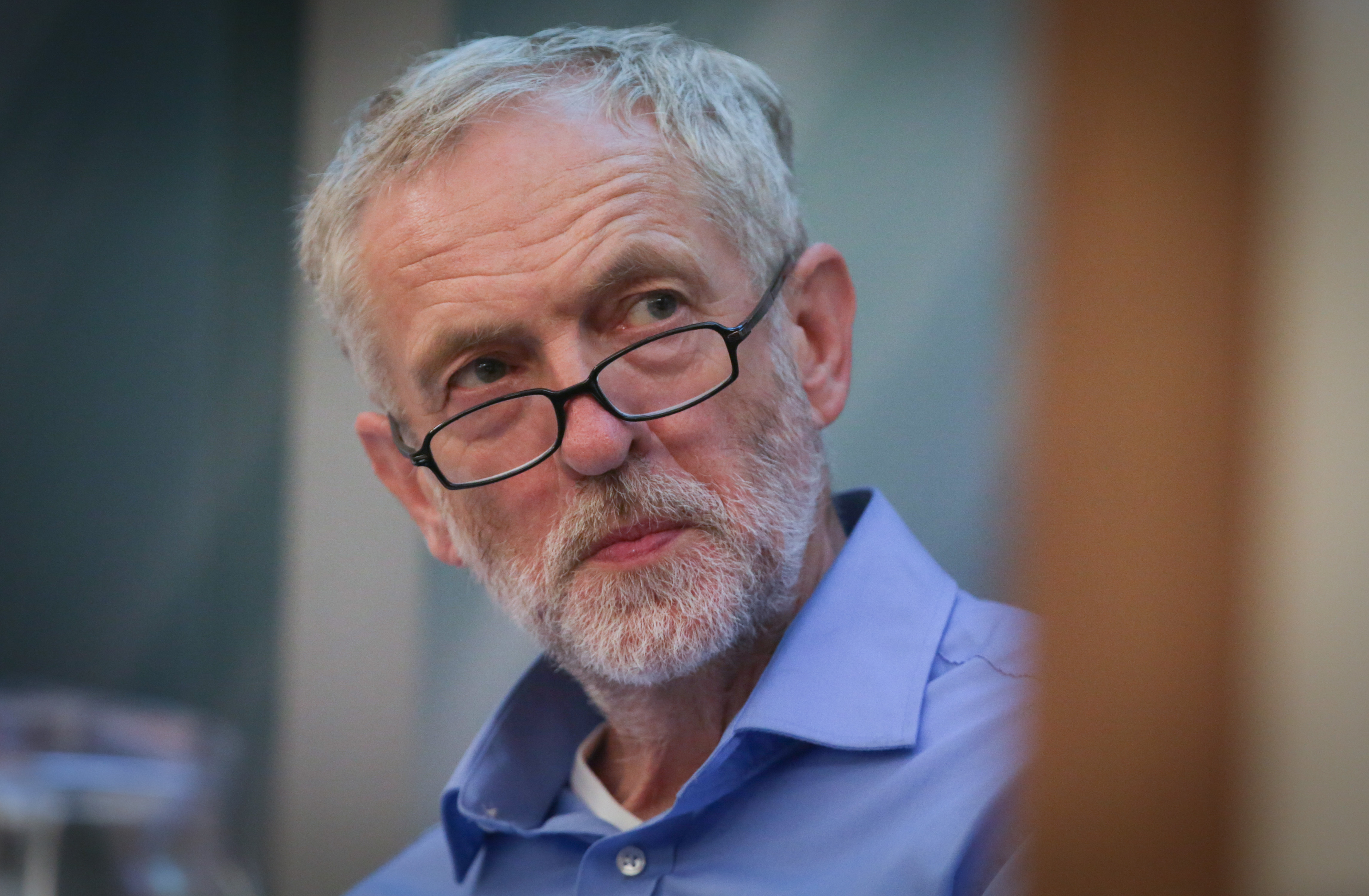 Labour leadership candidate Jeremy Corbyn listens to other speakers as he waits to speak at a rally for supporters at the Hilton at the Ageas Bowl  in Southampton, England, on Aug. 25, 2015.