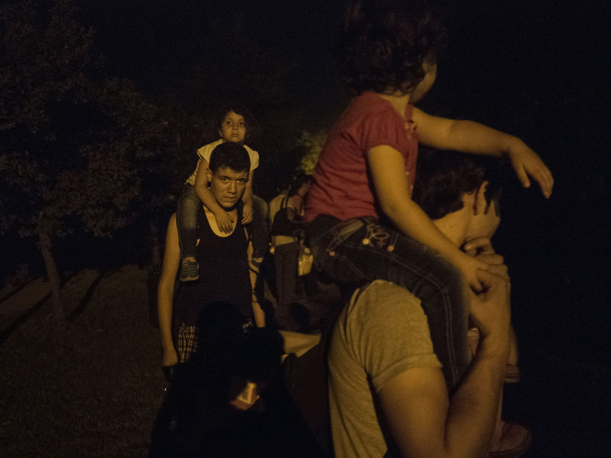 Horgos, Serbia. August 12, 2015. Syrian families walk at night toward the border to attempt to cross it.