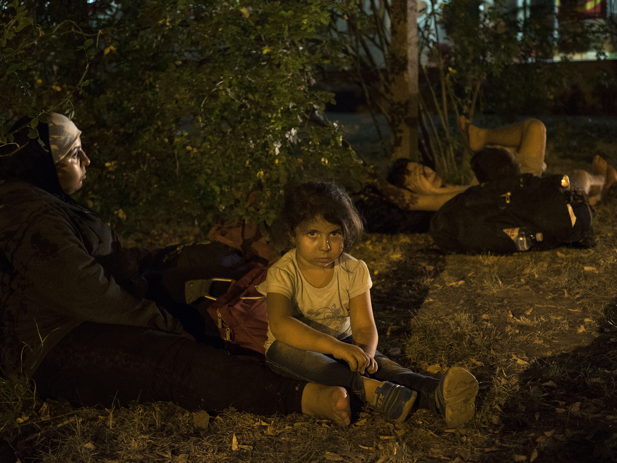 Horgos, Serbia. August 12, 2015. Syrian families wait for nightfall to walk toward the border to attempt to cross it.