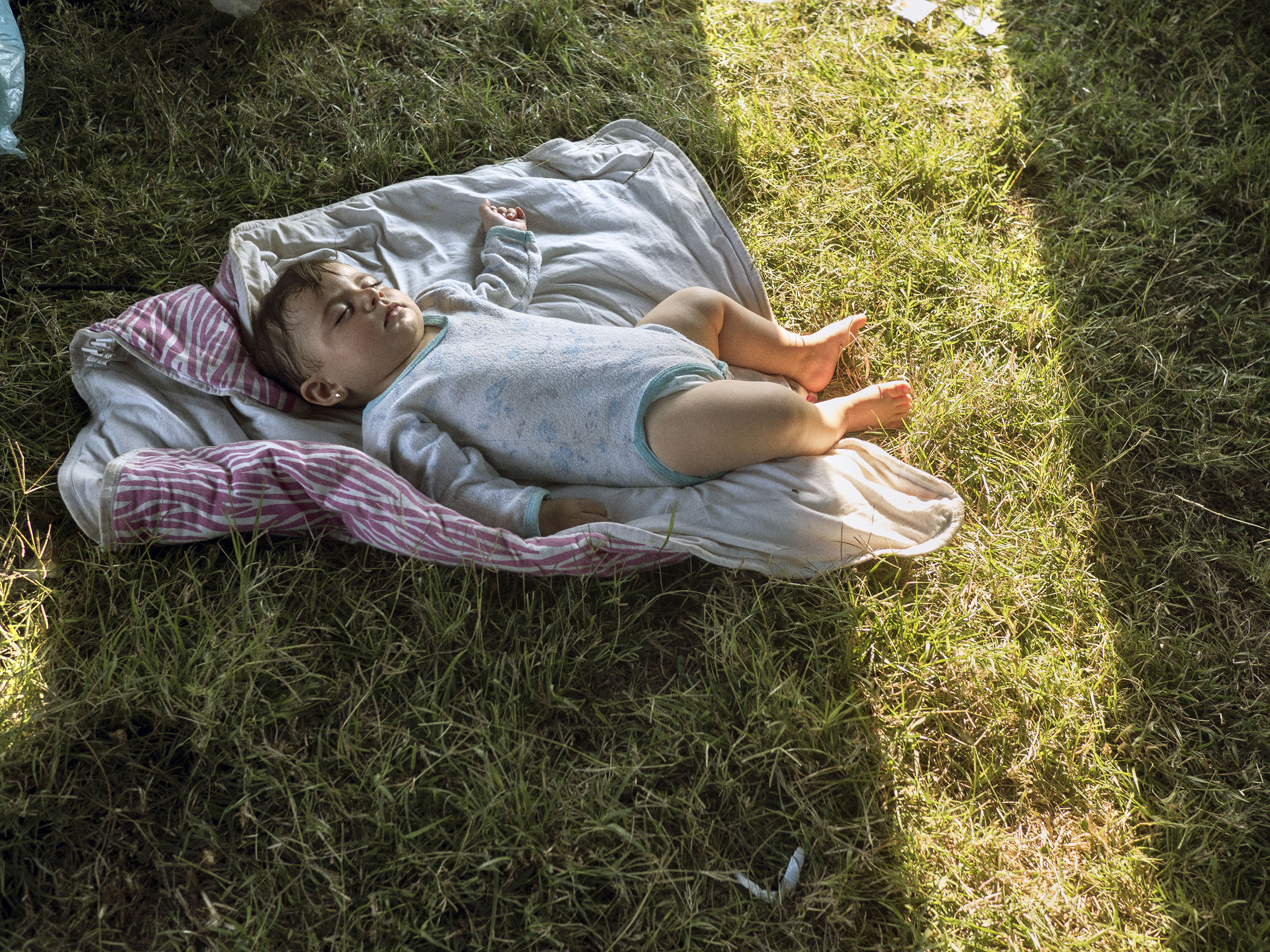 Vasariste, Serbia. August 12, 2015.                                   A child in a refugee camp near the Serbian-Hungarian border.