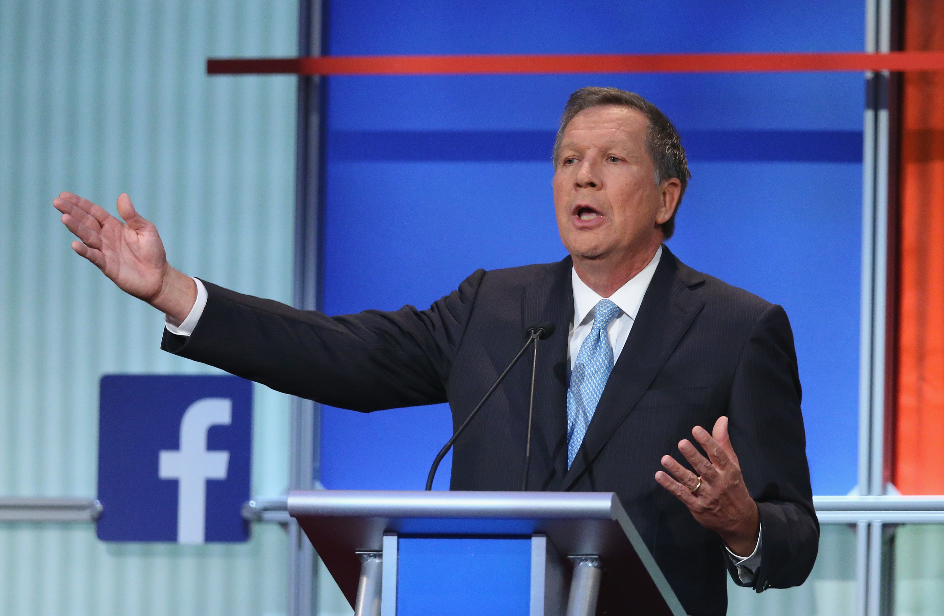 Republican presidential candidate Ohio Gov. John Kasich fields a question during the first Republican presidential debate hosted by Fox News and Facebook at the Quicken Loans Arena in Cleveland, Ohio, on Aug. 6, 2015.