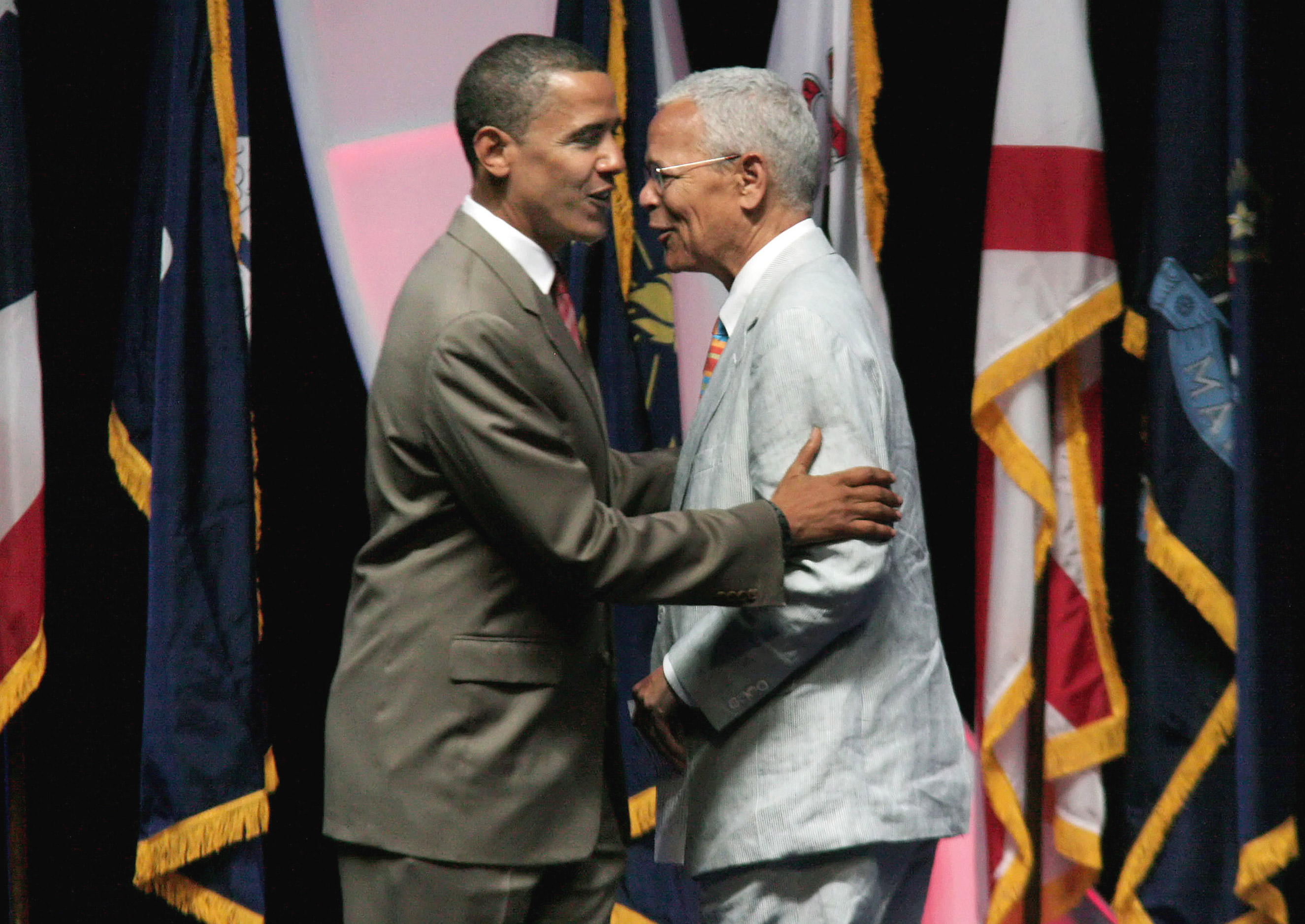 Democratic presidential candidate Senator Barack Obama shakes hands with NAACP Chairman Julian Bond before he speaks to supporters at the NAACP convention in Cincinnati on July 14, 2008.