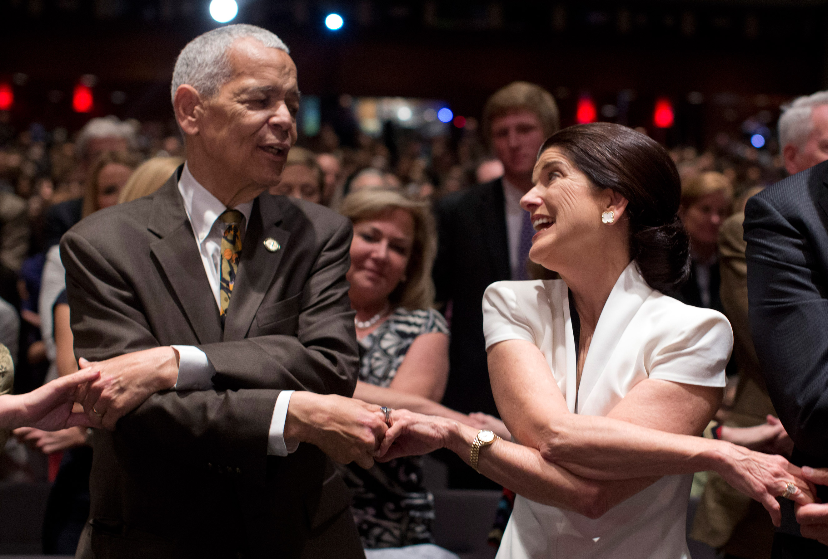 Julian Bond and Luci Baines Johnson, the younger daughter of President Lyndon Baines Johnson, join hands as they sing  We Shall Overcome  before President Barack Obama spoke at the LBJ Presidential Library on April 10, 2014, in Austin during the Civil Rights Summit to commemorate the 50th anniversary of the signing of the Civil Rights Act