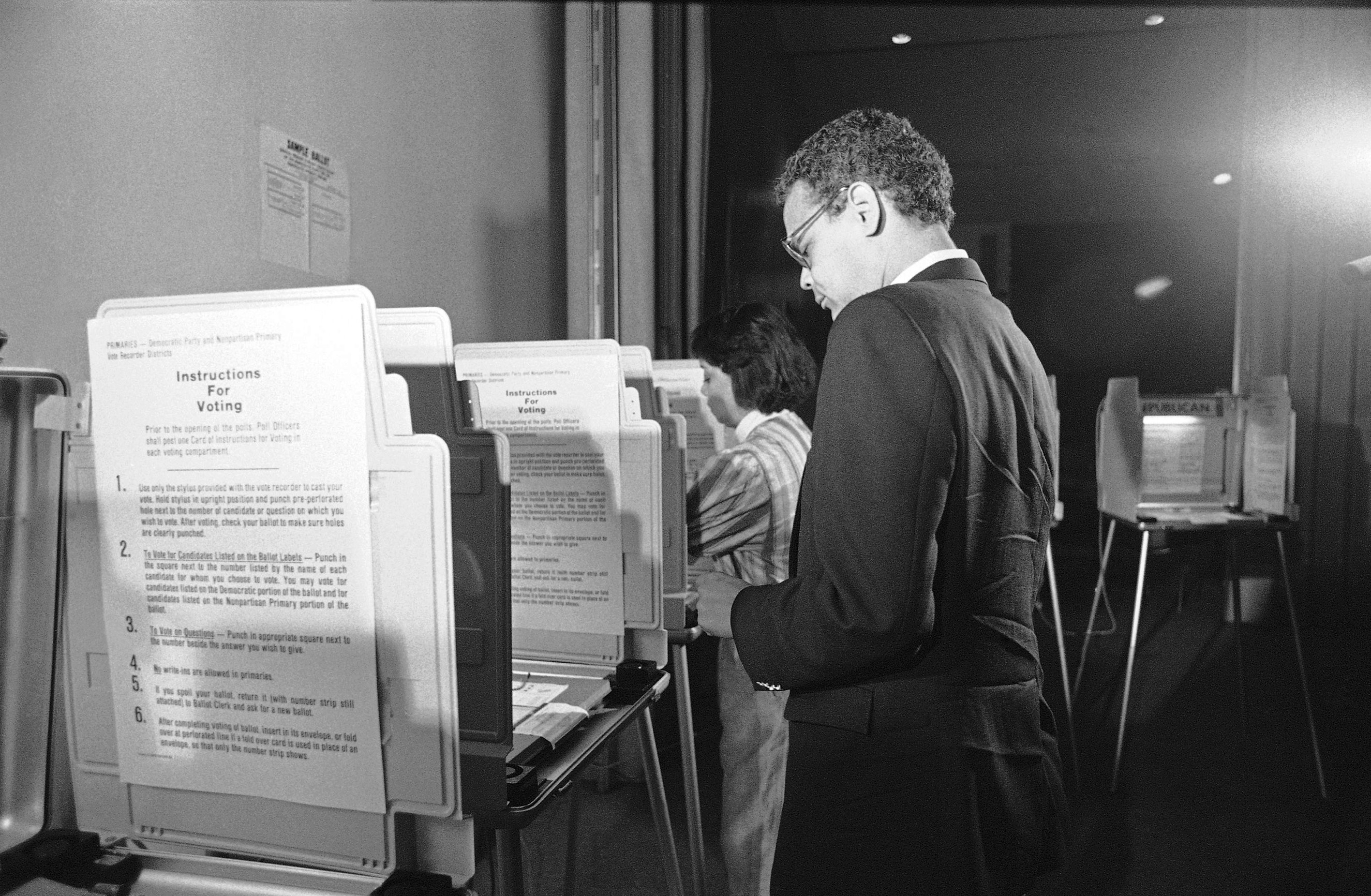 U.S. 5th Congressional District Democratic candidate Julian Bond marks his ballot on Sept. 2, 1986 at his polling place in downtown Atlanta. Bond was in a run-off election with John Lewis who won in a surprise victory.