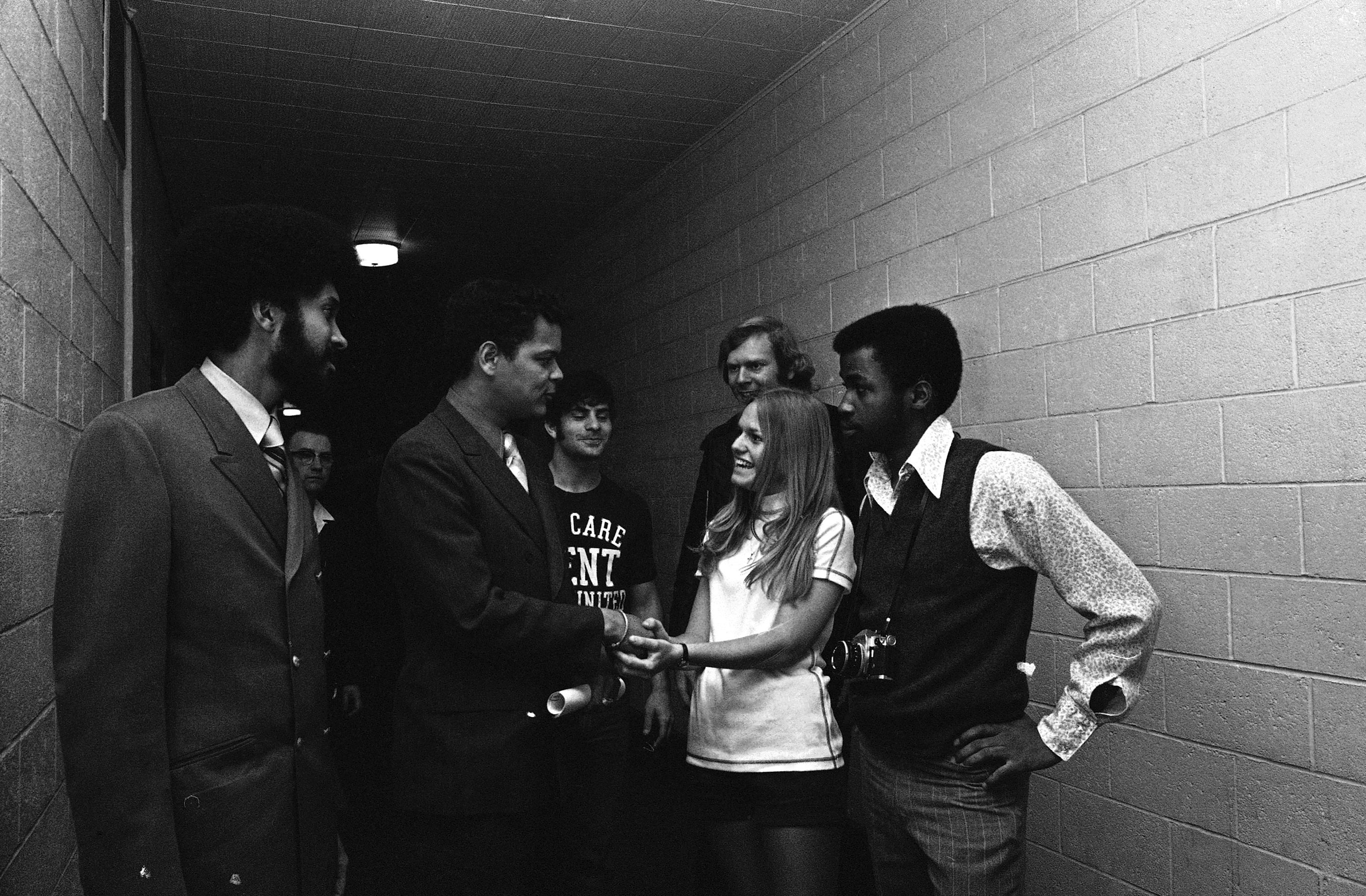 Julian Bond stops to talk with some Kent State University students before making a speech on May 2, 1971 at the campus in Kent, Ohio. Bond's speech was part of a four-day memorial period for the four students killed during campus demonstrations.