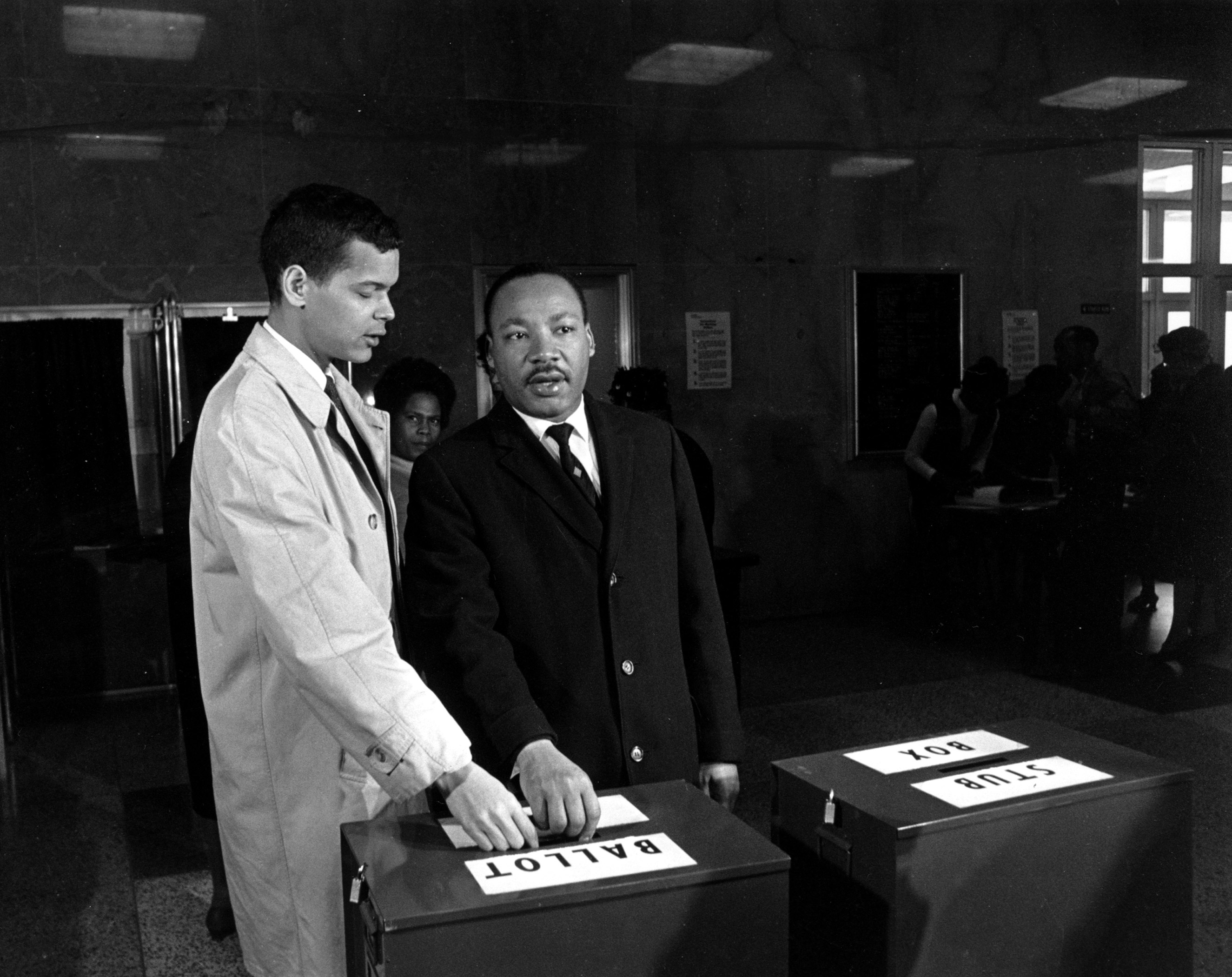 Julian Bond and Dr. Martin Luther King Jr. cast their ballots to fill Bond's vacant seat in the U.S. House of Representatives in Atlanta on Feb. 23, 1966.