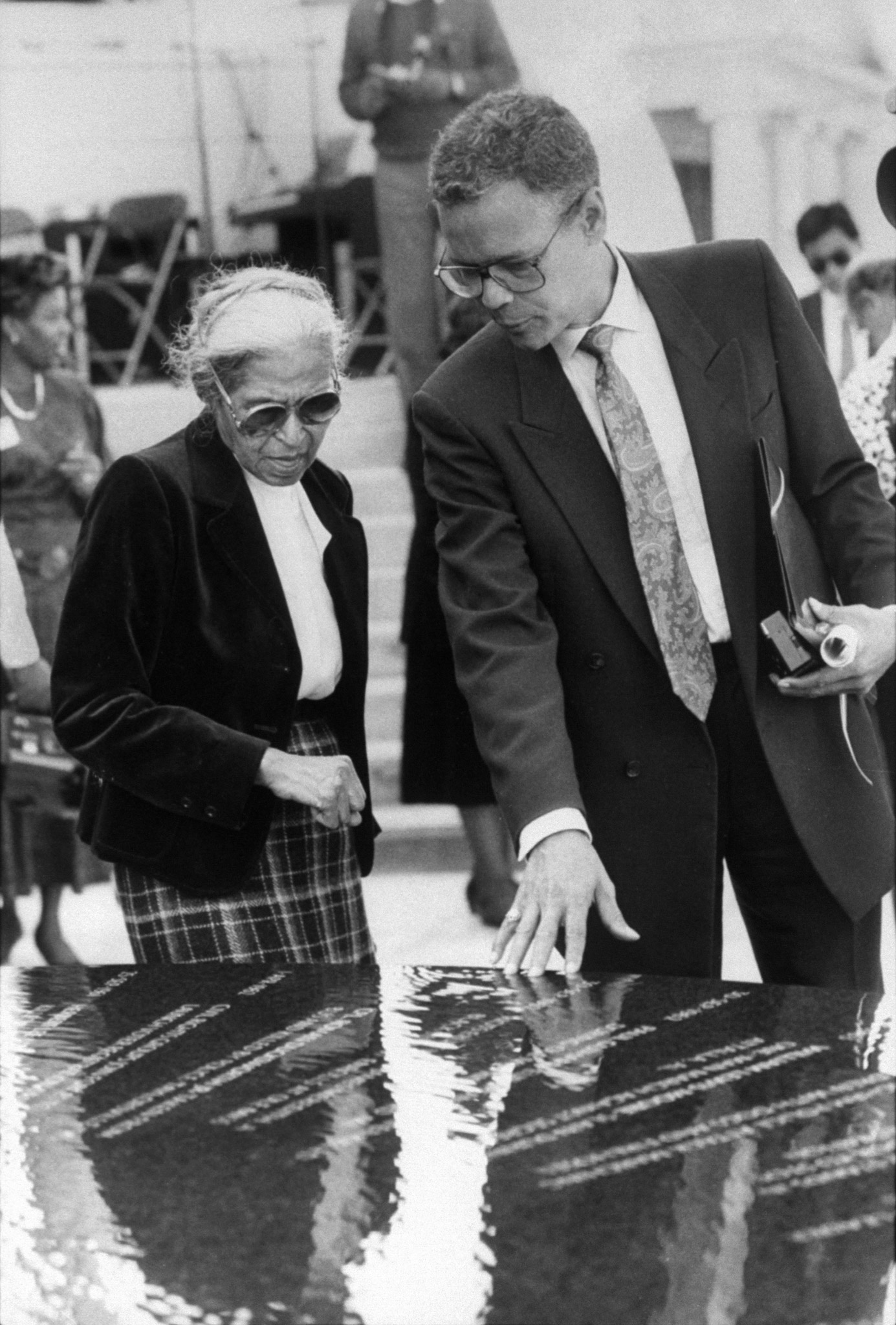 Julian Bond with Rosa Parks at a civil rights monument designed by architect Maya Lin, during a ceremony dedicating monument at Southern Poverty Law Center in Montgomery, Ala., on Nov. 6, 1989.
