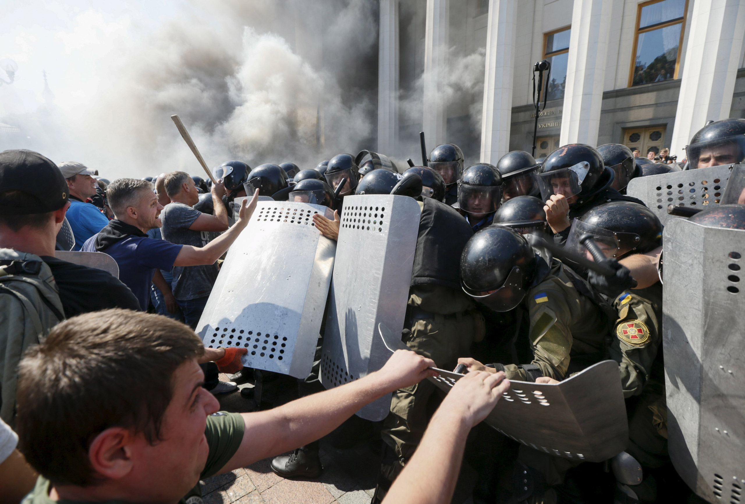 Protesters clash with police outside the parliament building in Kiev, Ukraine, on Aug. 31, 2015.