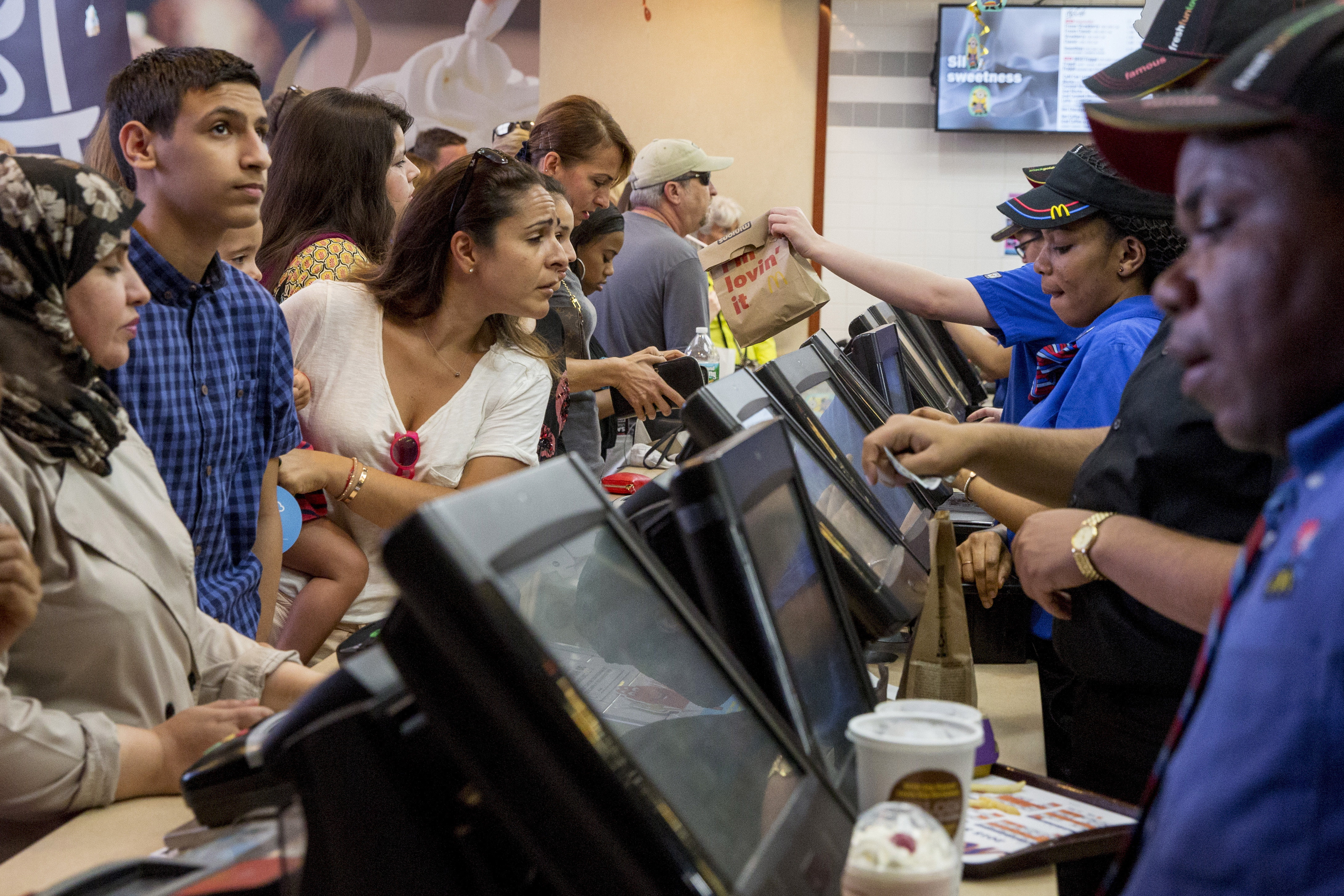 Customers are served at a McDonald's in Times Square in New York on July 23, 2015.