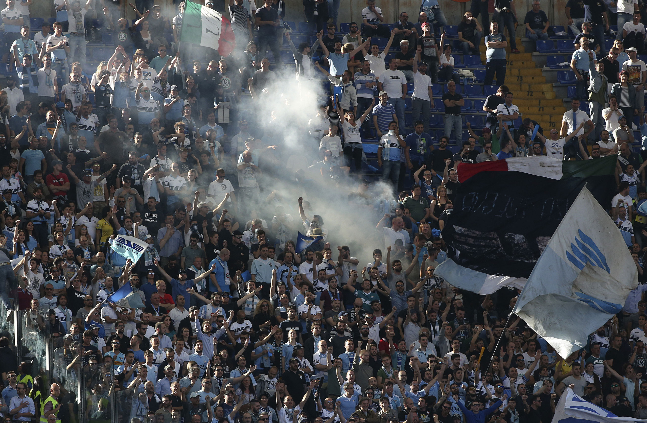 Lazio's supporters shout slogans before their Serie A soccer match against AS Roma at the Olympic stadium in Rome, on May 25, 2015.