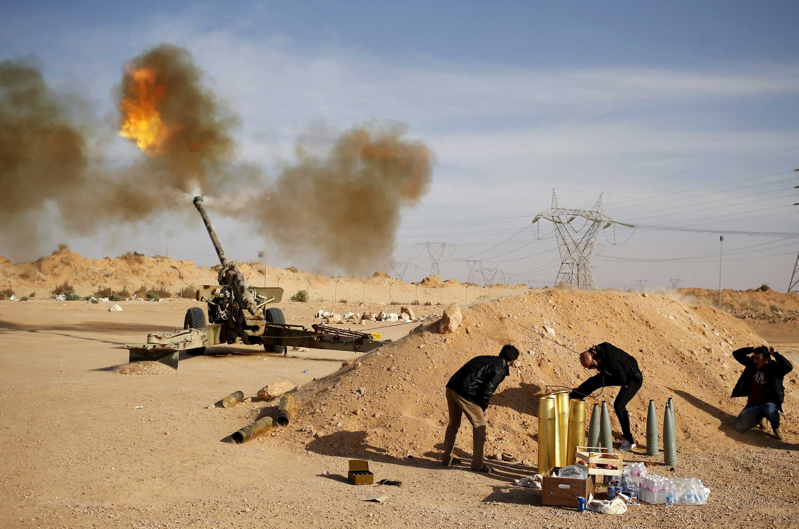 Libya Dawn fighters fire an artillery cannon at ISIS militants near Sirte in  March 2015.