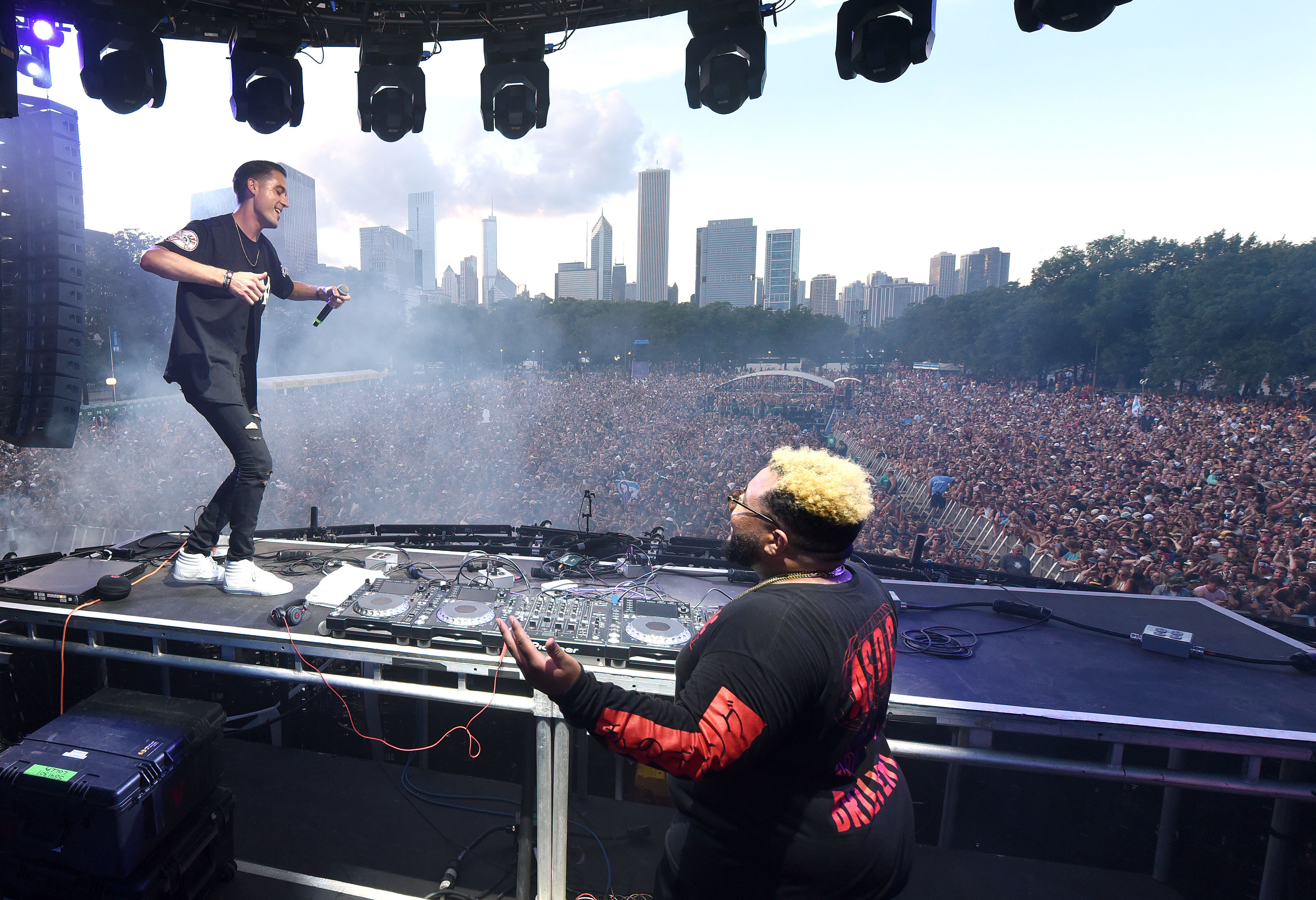 Rapper G-Easy and DJ-producer Carnage perform during the 2015 Lollapalooza Music Festival at Grant Park on Aug. 1, 2015 in Chicago, Ill.