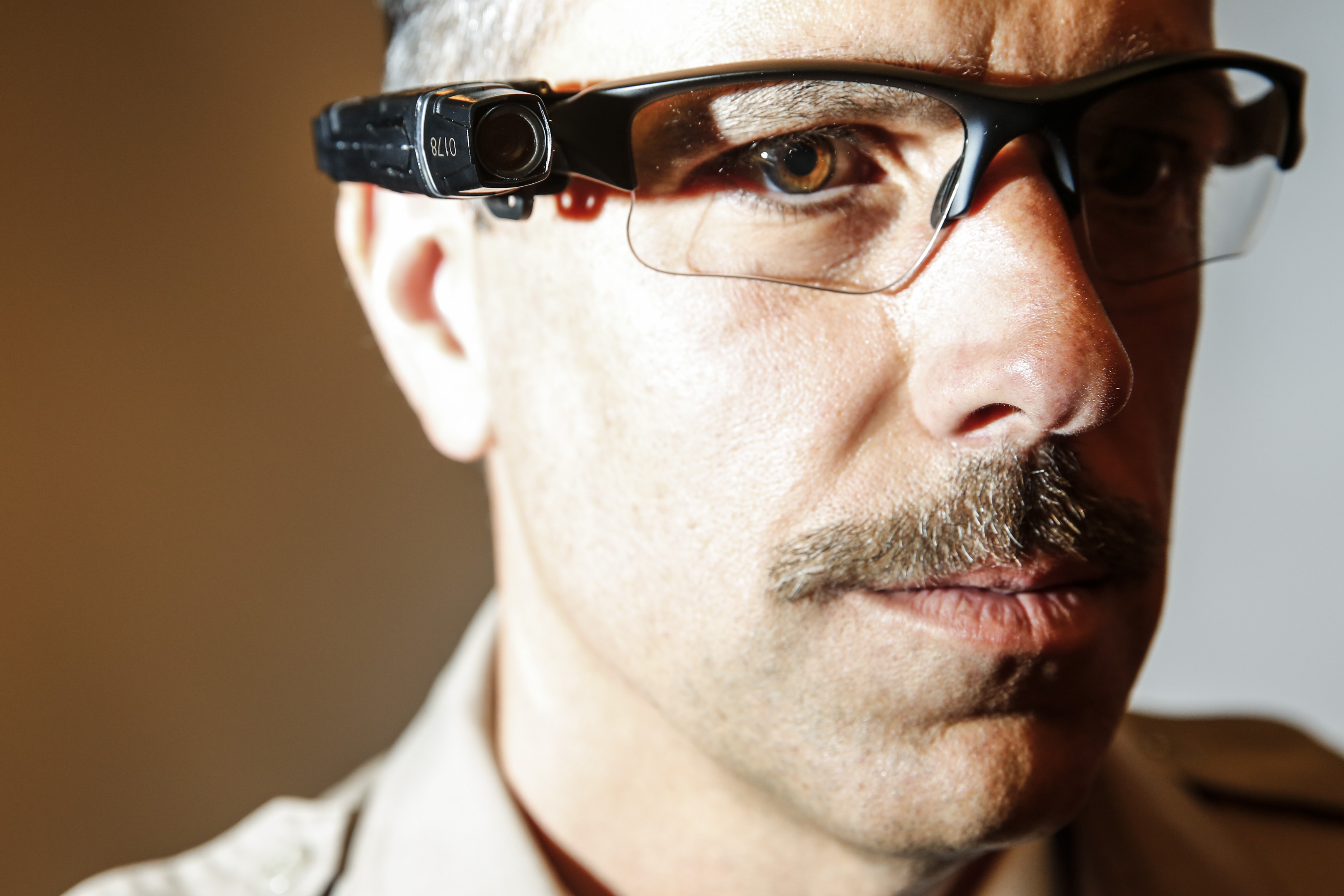 County of Los Angeles Sheriff's Lt. Chris Marks poses wearing the Taser Axon Flex, on-officer camera system attached to glasses in Monterey Park on Sept. 17, 2014.