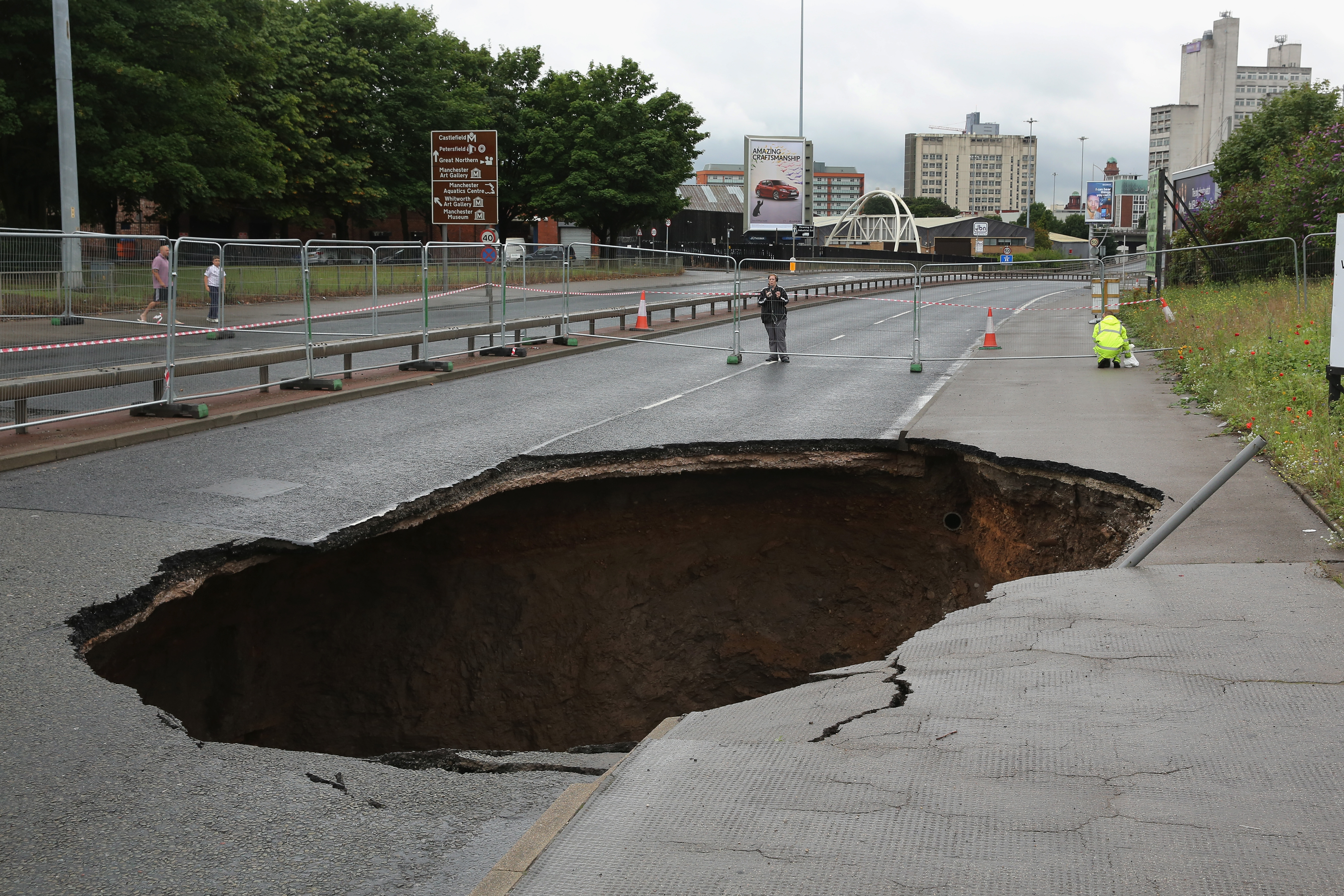 A sink hole appears on Mancunian Way in Manchester after heavy rain on August 14, 2015 in Manchester, England.