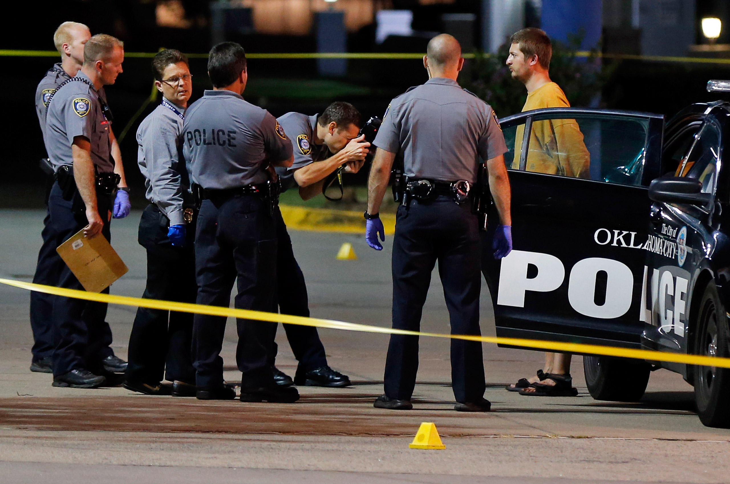 Police arresting Christian Costello, son of Oklahoma Labor Commissioner Mark Costello, on a first-degree murder complaint for fatally stabbing his father at a restaurant in Oklahoma City, on Aug. 23, 2015.