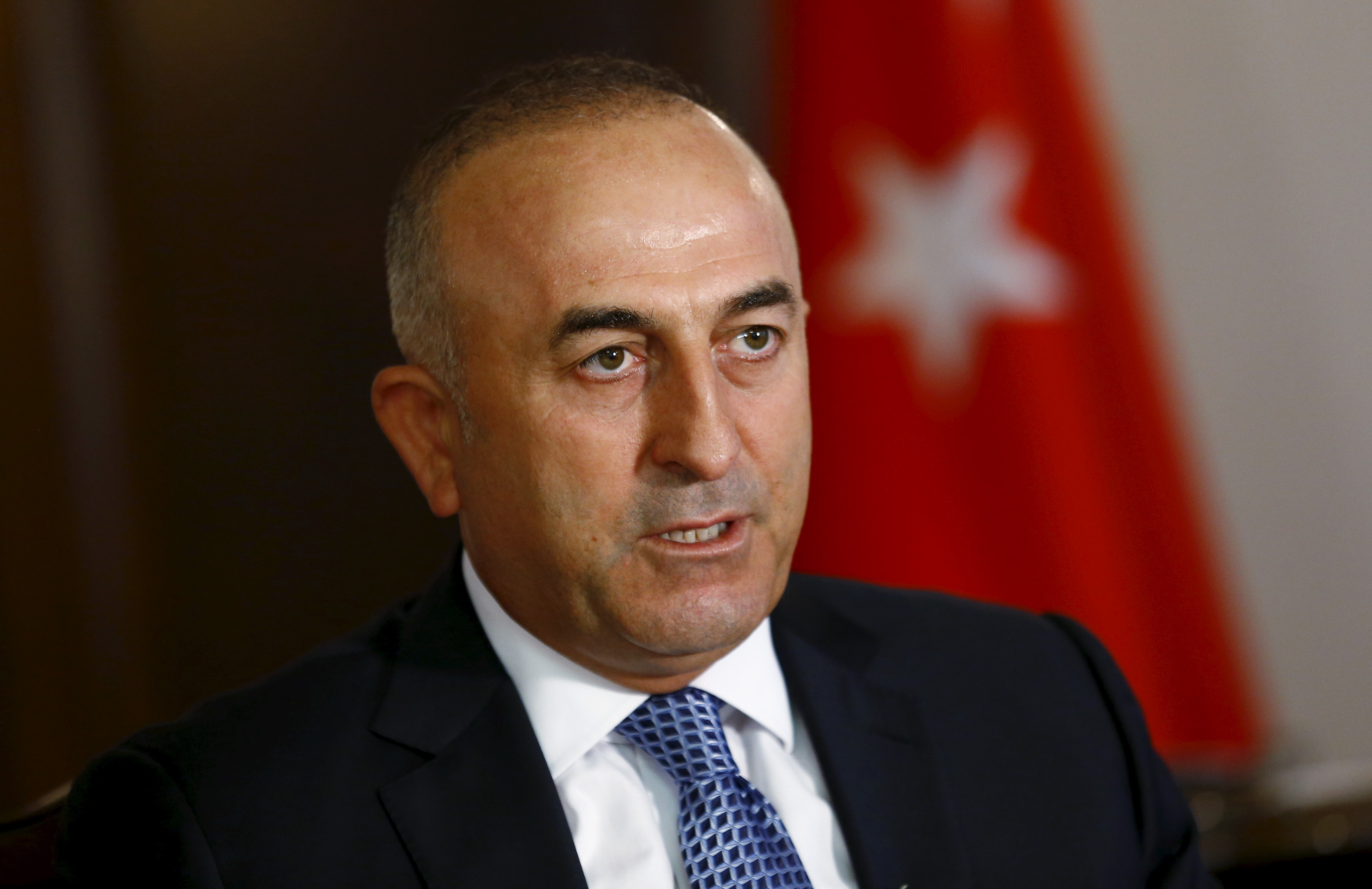 Turkey's Foreign Minister Mevlut Cavusoglu answers a question during an interview in Ankara on Aug. 24, 2015