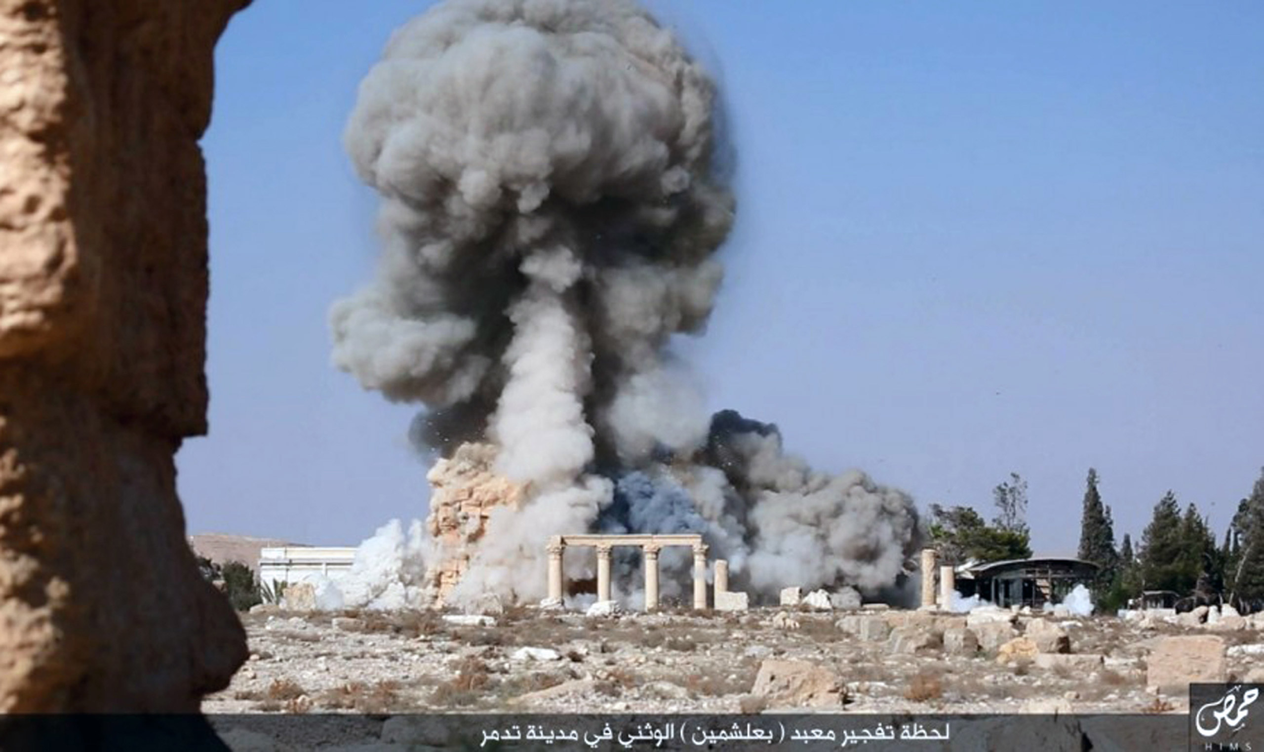 This undated photo released on Aug. 25, 2015 on a social media site used by Islamic State of Iraq and Syria (ISIS) militants shows smoke from the detonation of the 2,000-year-old temple of Baalshamin in the ancient caravan city of Palmyra, Syria.