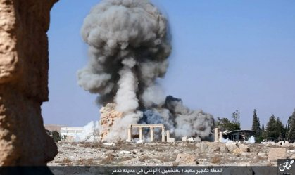 "This undated photo released Tuesday, Aug. 25, 2015 on a social media site used by Islamic State militants, which has been verified and is consistent with other AP reporting, shows smoke from the detonation of the 2,000-year-old temple of Baalshamin in Syria's ancient caravan city of Palmyra. A resident of the city said the temple was destroyed on Sunday, a month after the group's militants booby-trapped it with explosives. Arabic at bottom reads, ""The moment of detonation of the pagan Baalshamin temple in the city of Palmyra."" (Islamic State social media account via AP)"