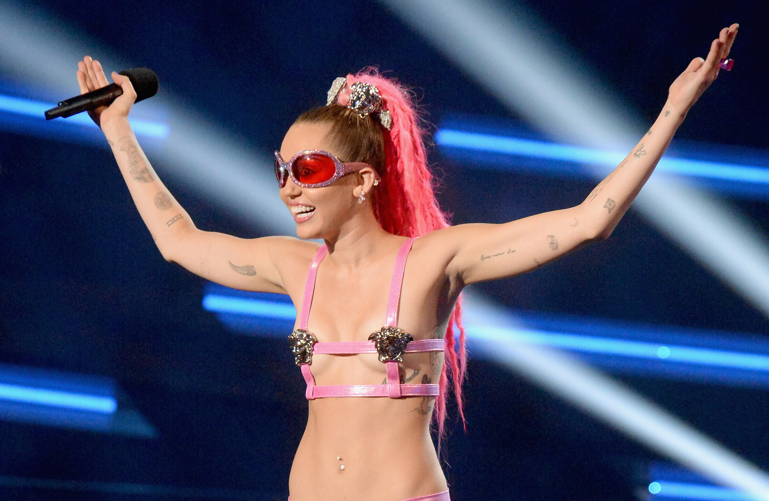 Miley Cyrus speaks onstage during the 2015 MTV Video Music Awards at Microsoft Theater in Los Angeles on Aug. 30, 2015.