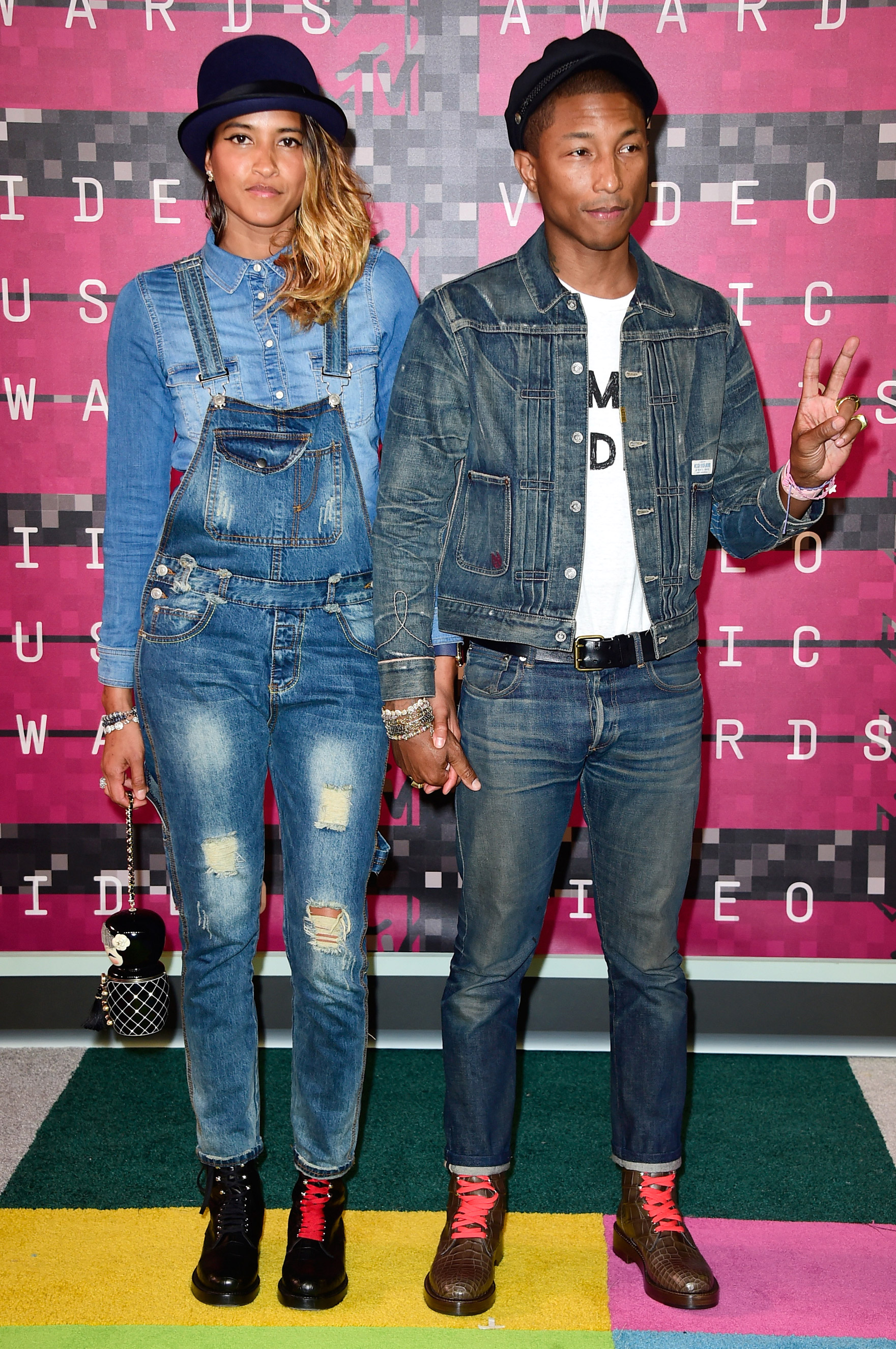 From left: Model Helen Lasichanh  and Pharrell Williams arrive at the 2015 MTV Video Music Awards at Microsoft Theater on Aug. 30, 2015 in Los Angeles.