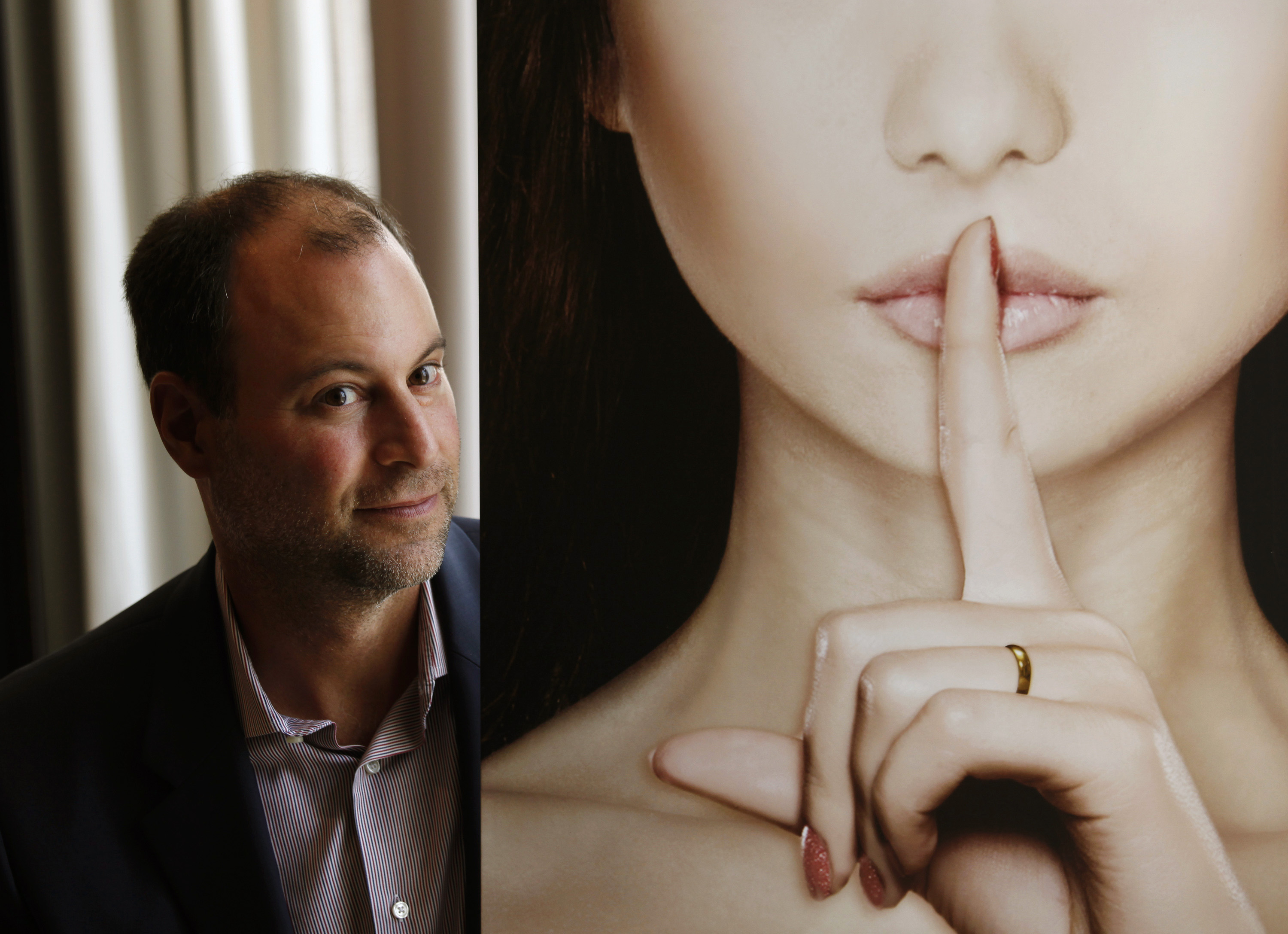 Ashley Madison founder Noel Biderman poses during an interview in Hong Kong on Aug. 28, 2013.