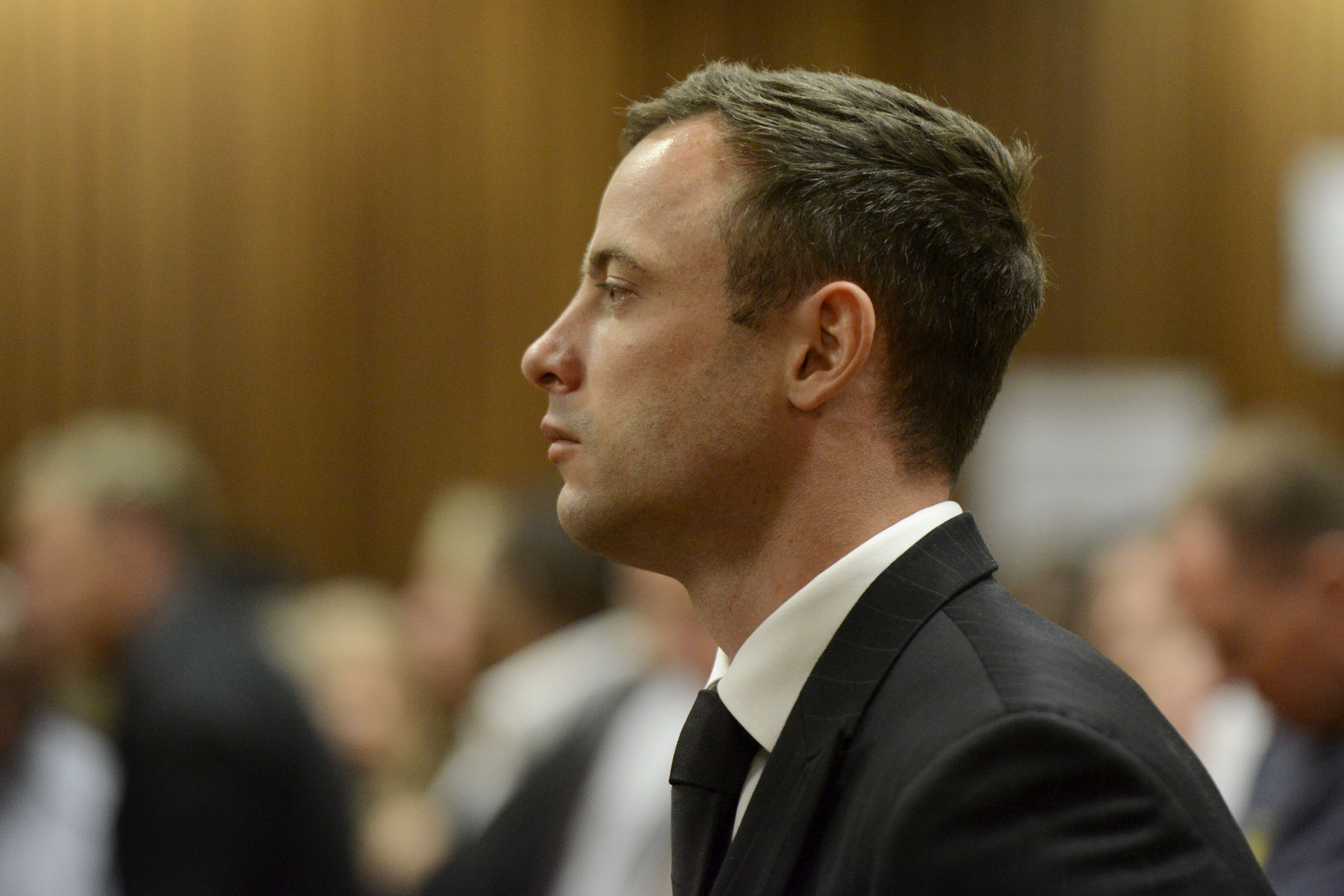 Oscar Pistorius listens to his judgement in the Pretoria High Court on Oct. 21, 2014, in Pretoria, South Africa.