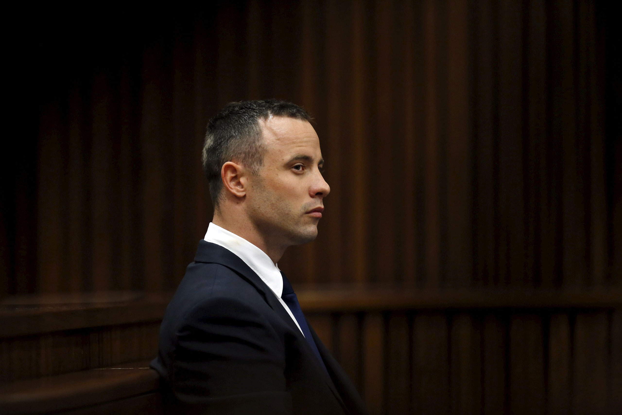Oscar Pistorius  sits in the dock during his trial in the North Gauteng High Court in Pretoria, on May 6, 2014.