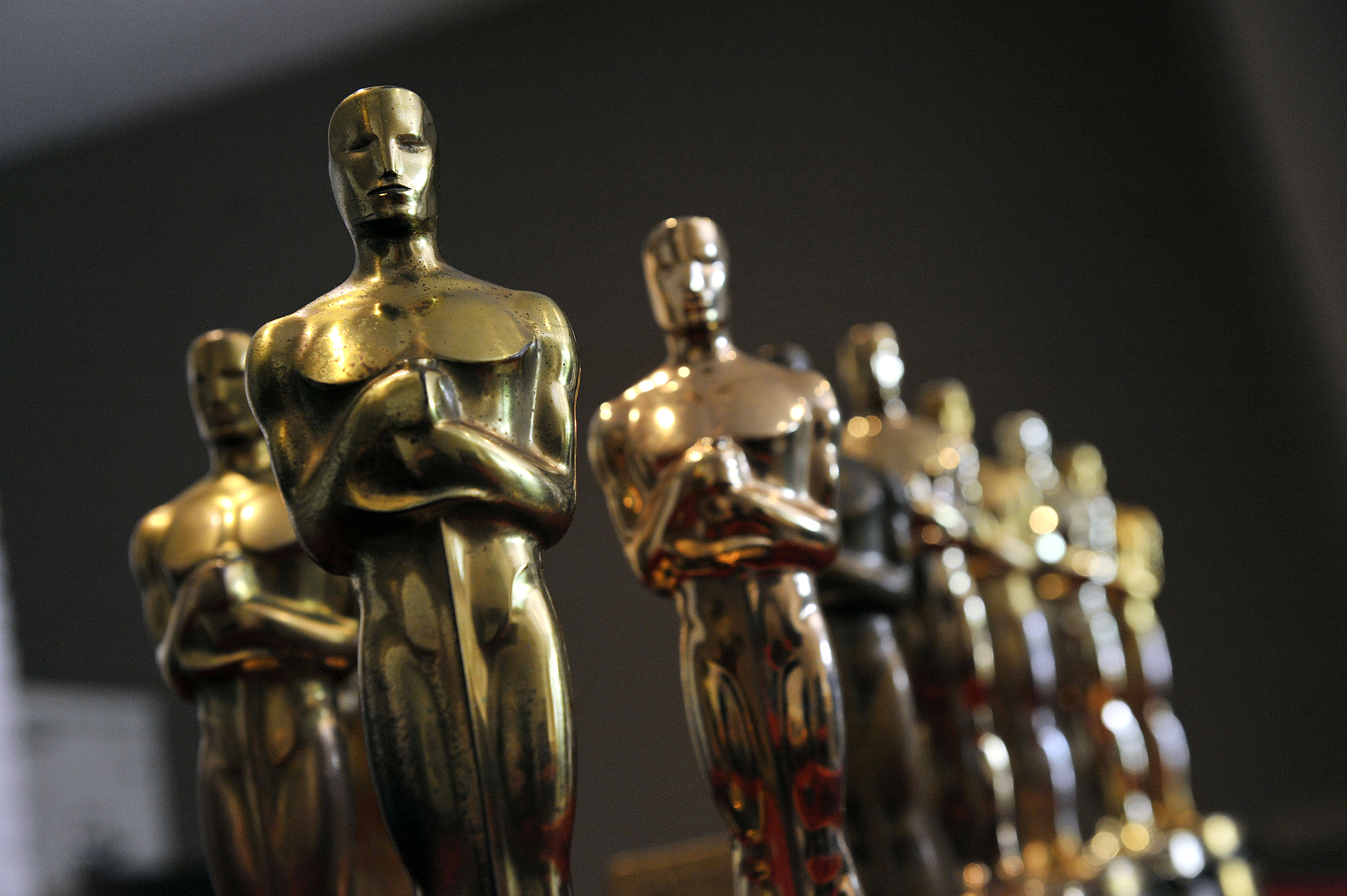 Nate Sanders displays the collection of Oscar statuettes that his auction company will sell online to the highest bidder on February 24, 2012 in Brentwood, Calif.