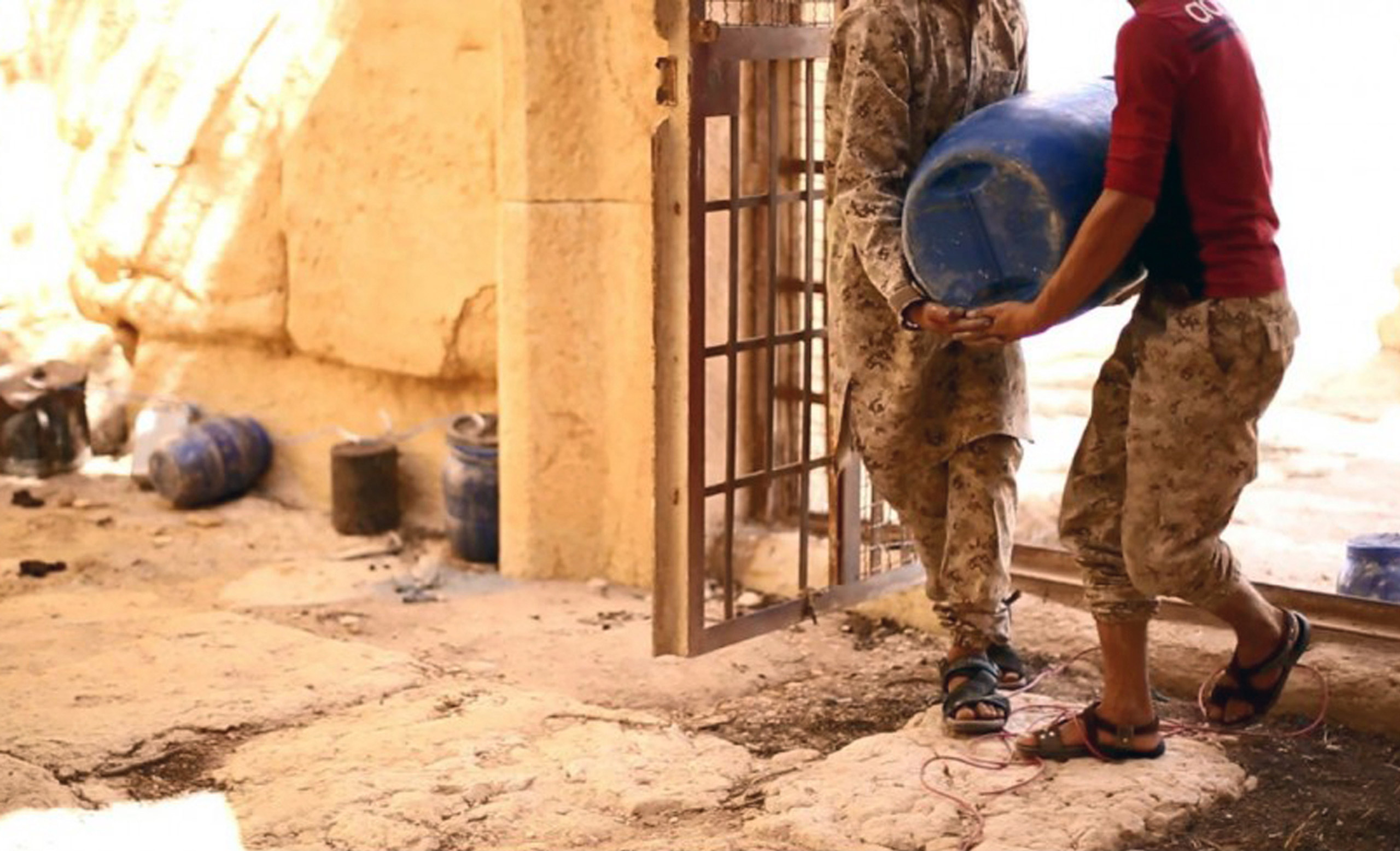 This undated photo released on Aug. 25, 2015 on a social media site used by ISIS militants shows militants laying explosives in the 2,000-year-old temple of Baalshamin in Palmyra, Syria.