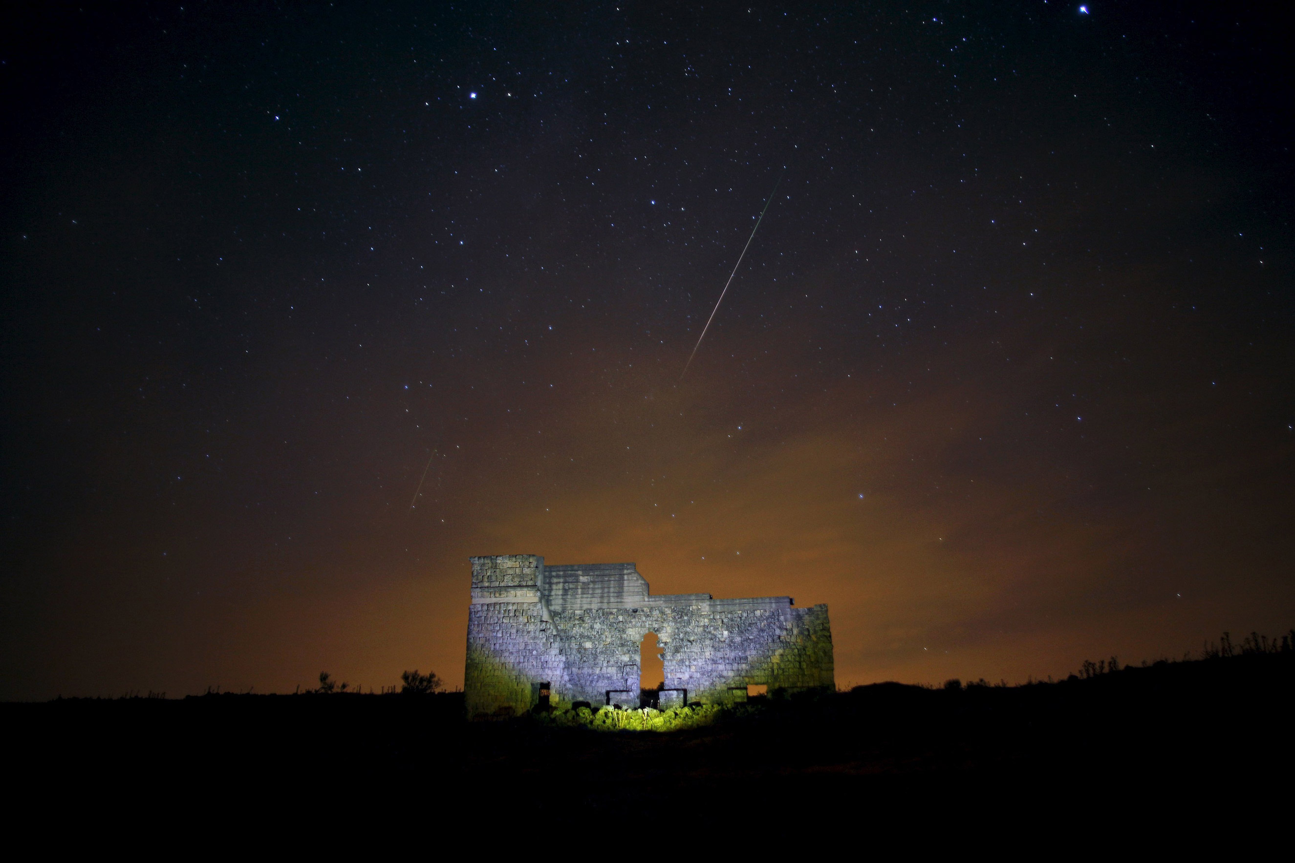 The Perseid meteor shower over a Roman theatre in the ruins of Acinipio near Seville, Spain on Aug. 13, 2015