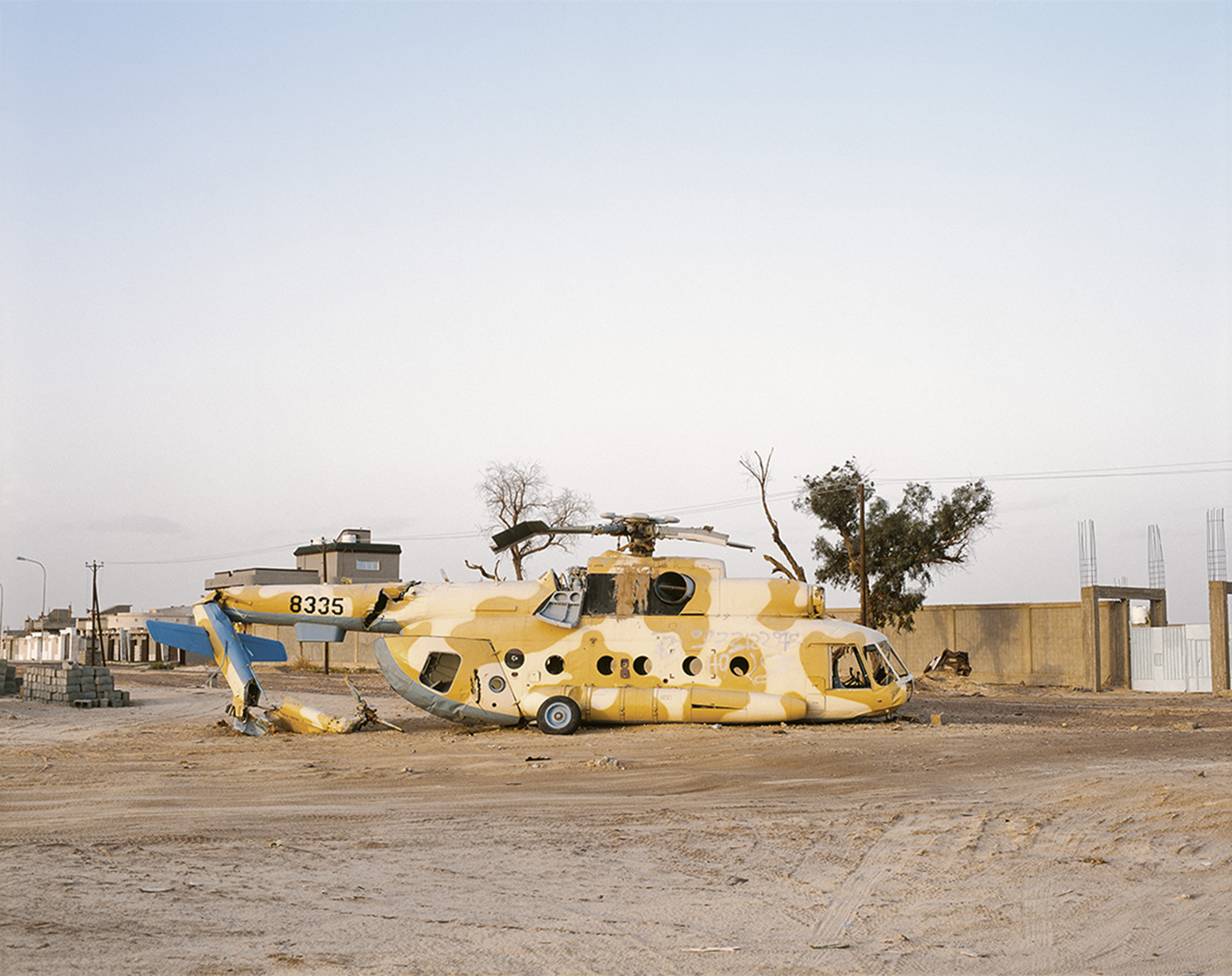 The remains of a Libyan National Army MI8 helicopter that crash-landed from overloading in 2012, during the reconciliation tour operated in Southern Libya by the Tripoli authorities. Murzuk, Southern Libya, March 2015.