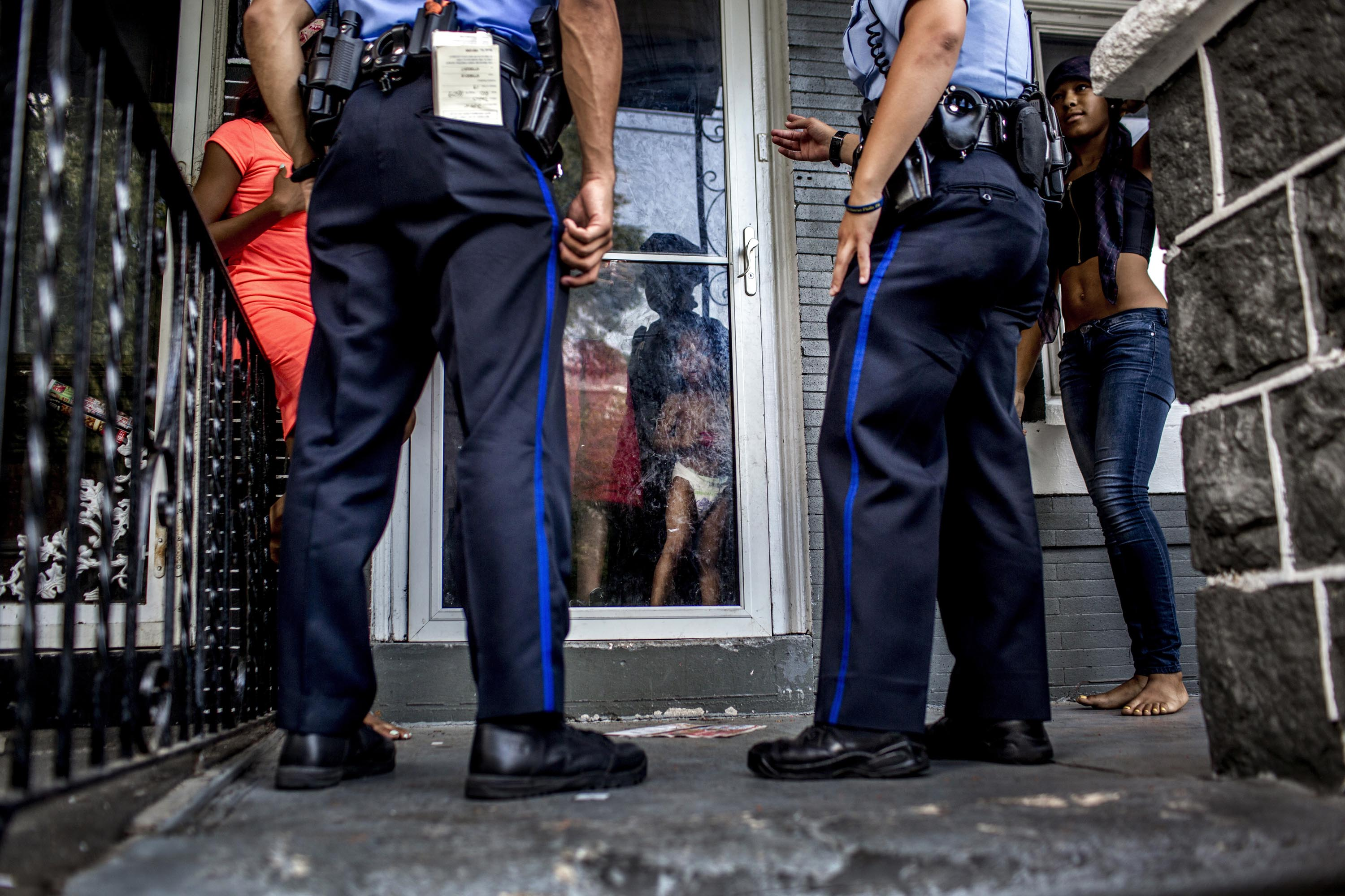 Police officers respond to a young woman who said she was threatened by an ex-boyfriend on July 28 in Philadelphia's 19th District