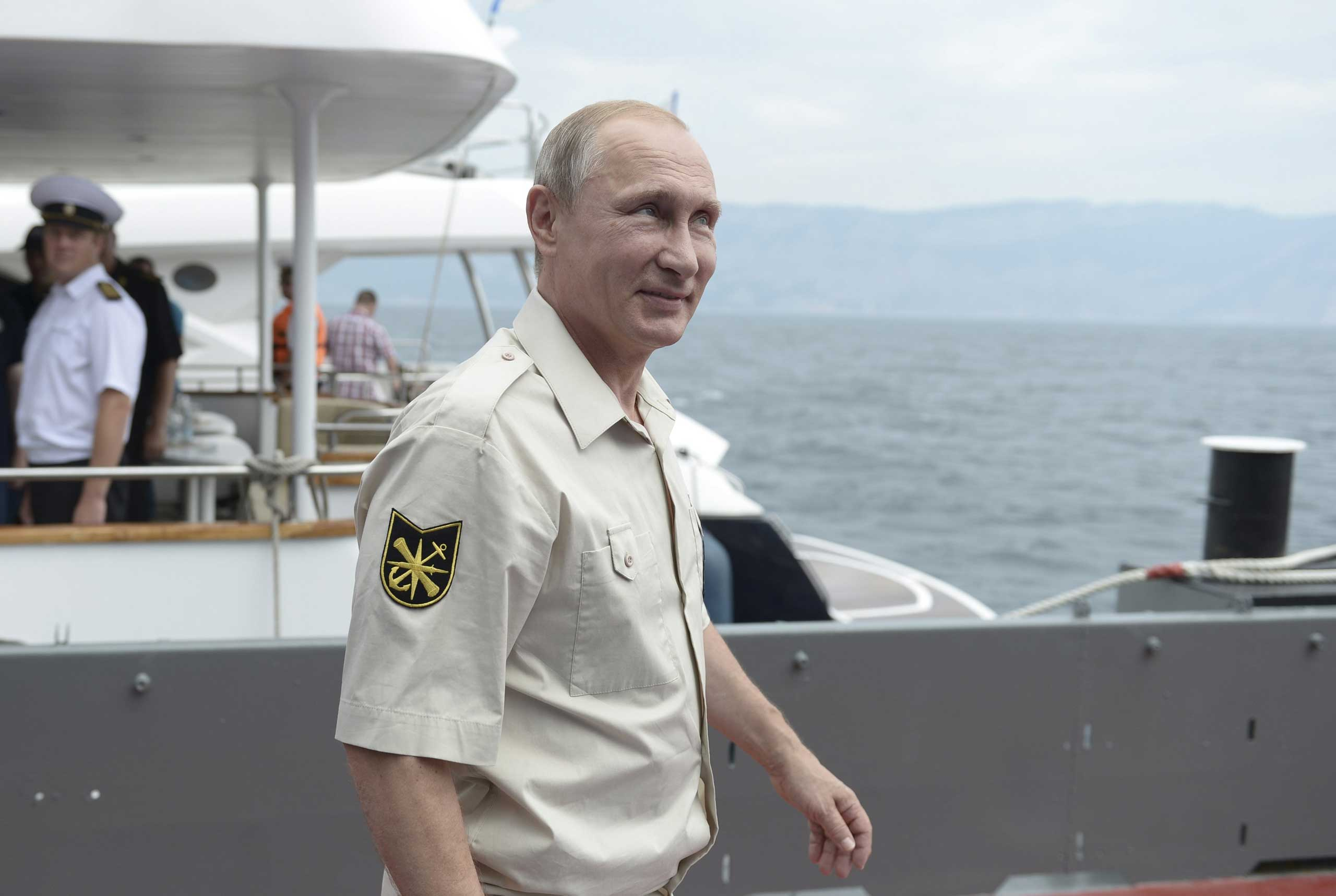 President Putin walks before submerging into the waters of the Black Sea inside a research bathyscaphe as part of an expedition near Sevastopol, on Aug. 18, 2015.