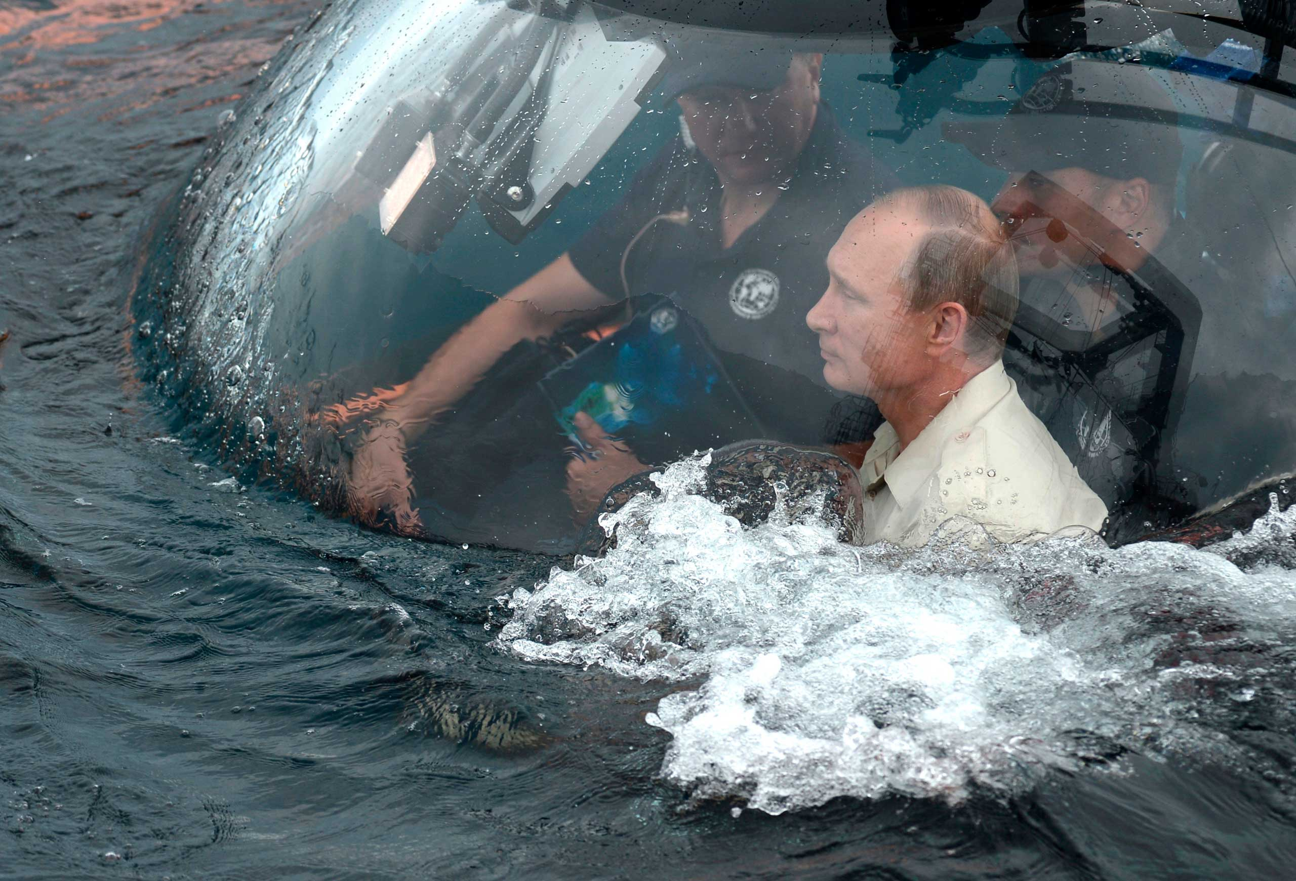 President Putin sits on board a bathyscaphe as it plunges into the Black Sea along the coast of Sevastopol, on  Aug. 18, 2015.