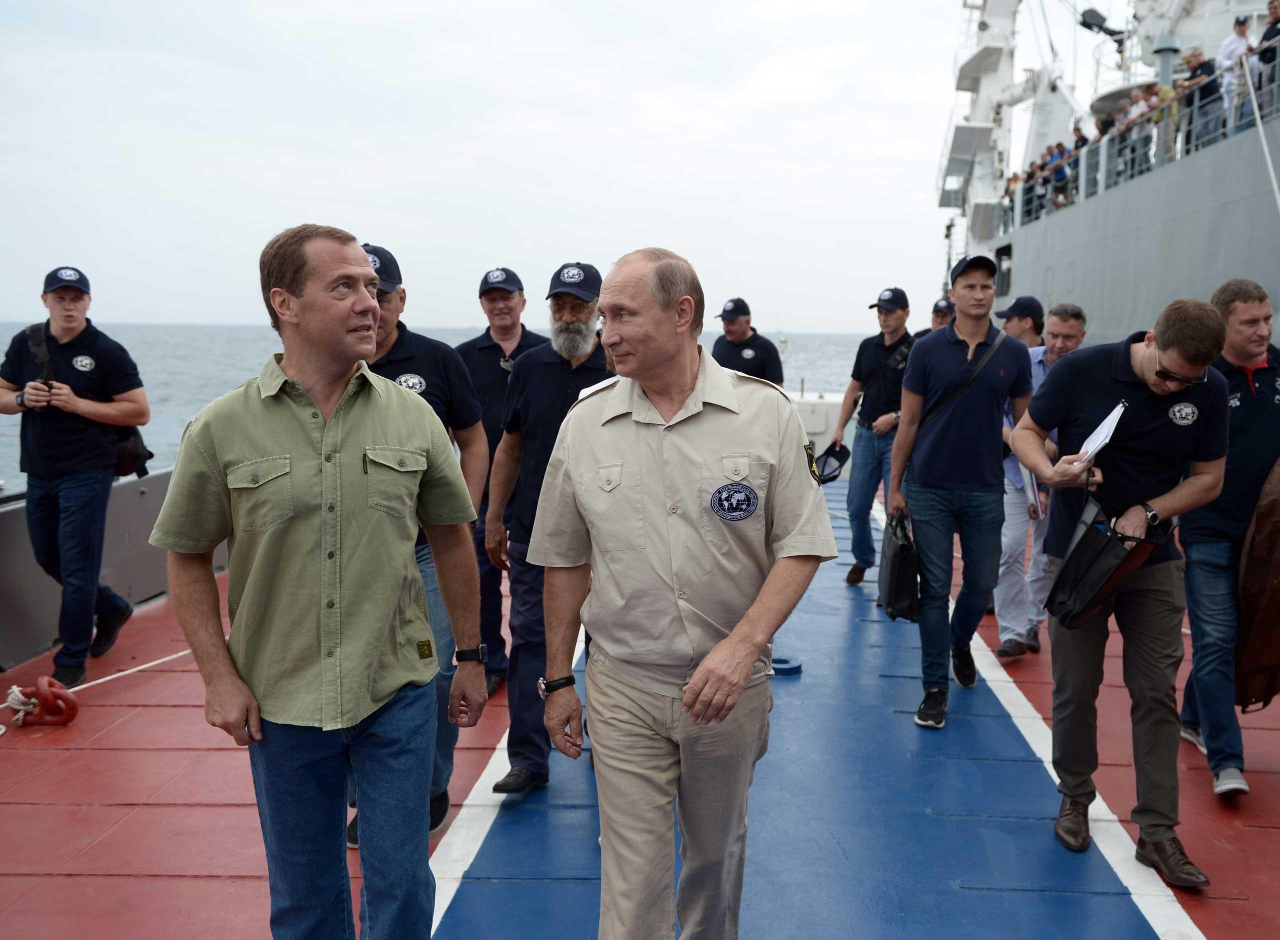 President Vladimir Putin and Prime Minister Dmitry Medvedev in Sevastopol, on Aug. 18,  2015.