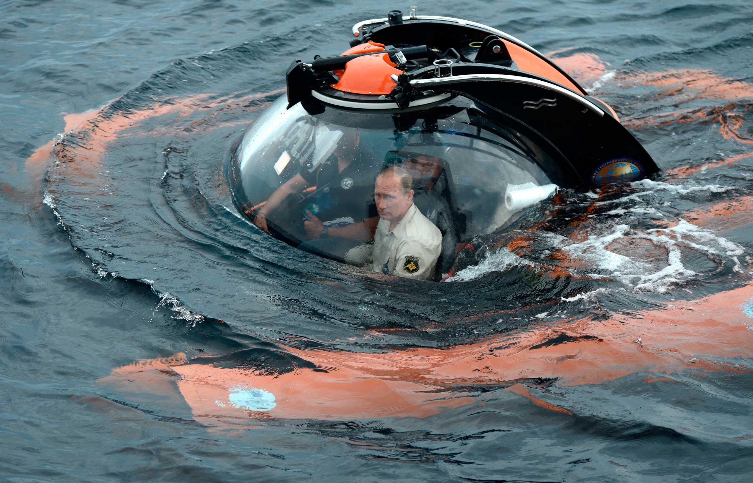 President Vladimir Putin sits on board a bathyscaphe as it plunges into the Black sea along the coast of Sevastopol, Crimea, on Aug. 18, 2015.