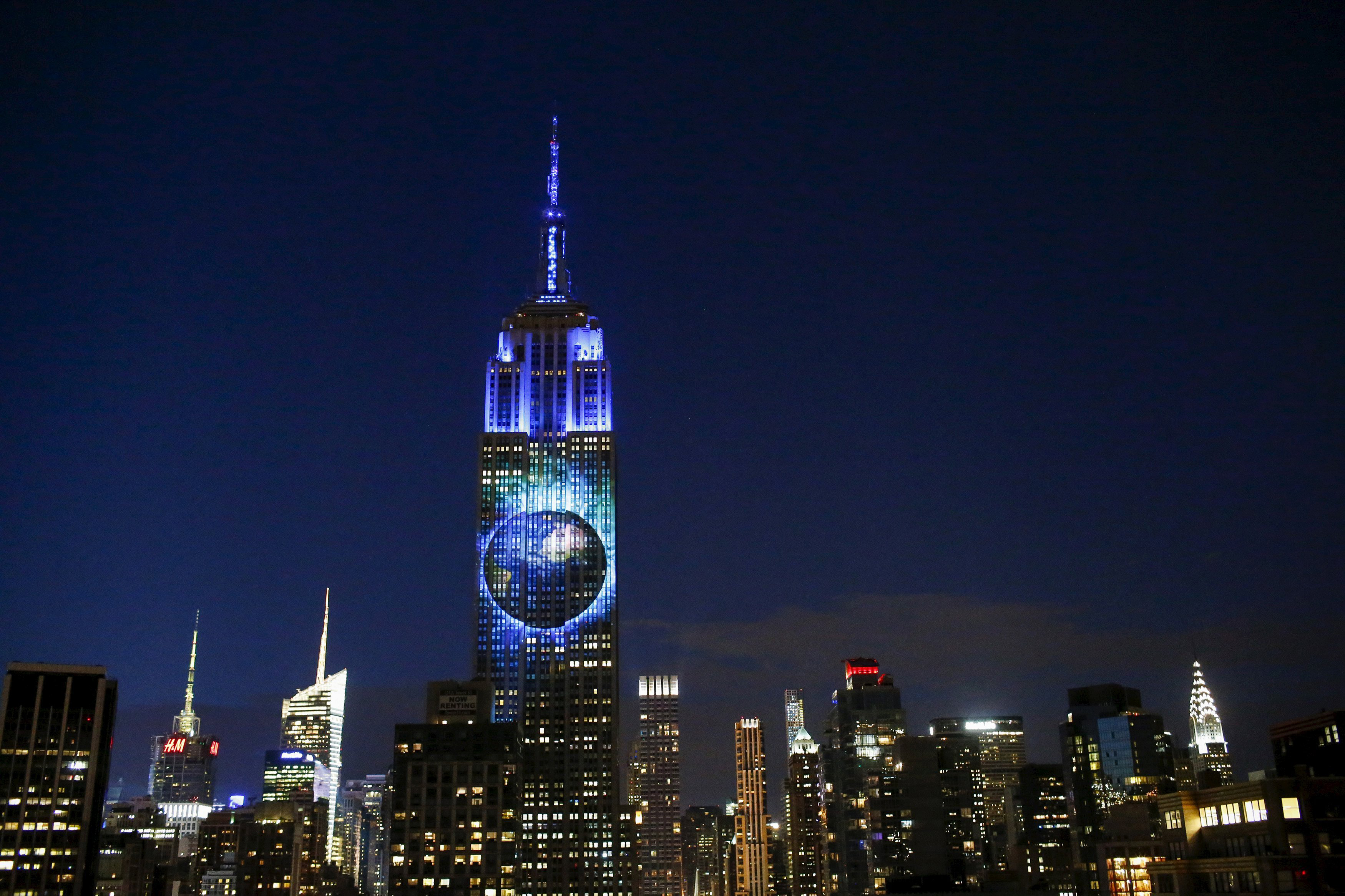 An image of the earth is projected onto the Empire State Building as part of a project to raise awareness about endangered species, in New York City on August 1, 2015.