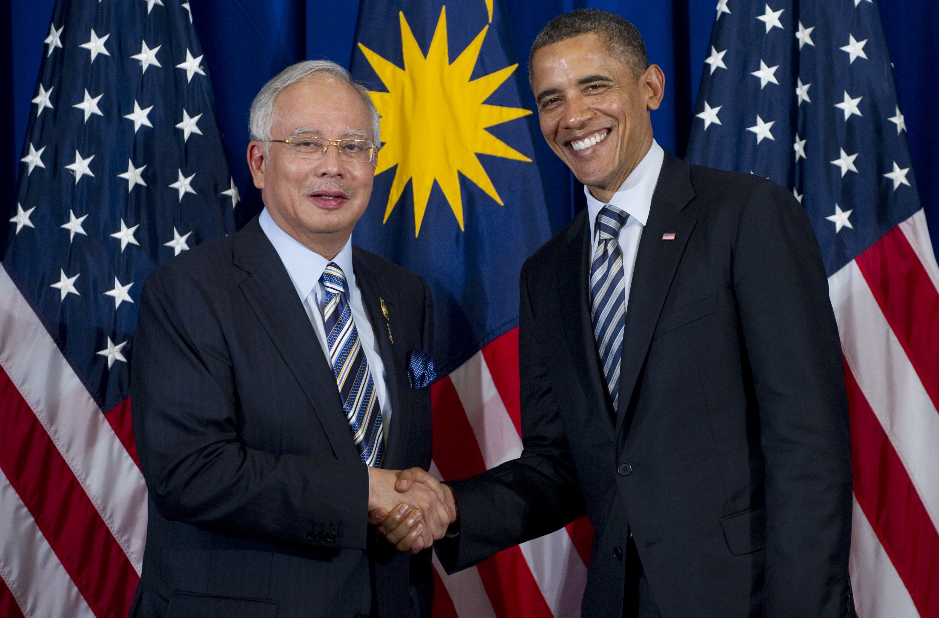 U.S. President Barack Obama shakes hands with Prime Minister Najib Razak of Malaysia during a meeting on the sidelines of the ASEAN and East Asia summits in Nusa Dua on Indonesia's resort island of Bali, on Nov. 18, 2011.
